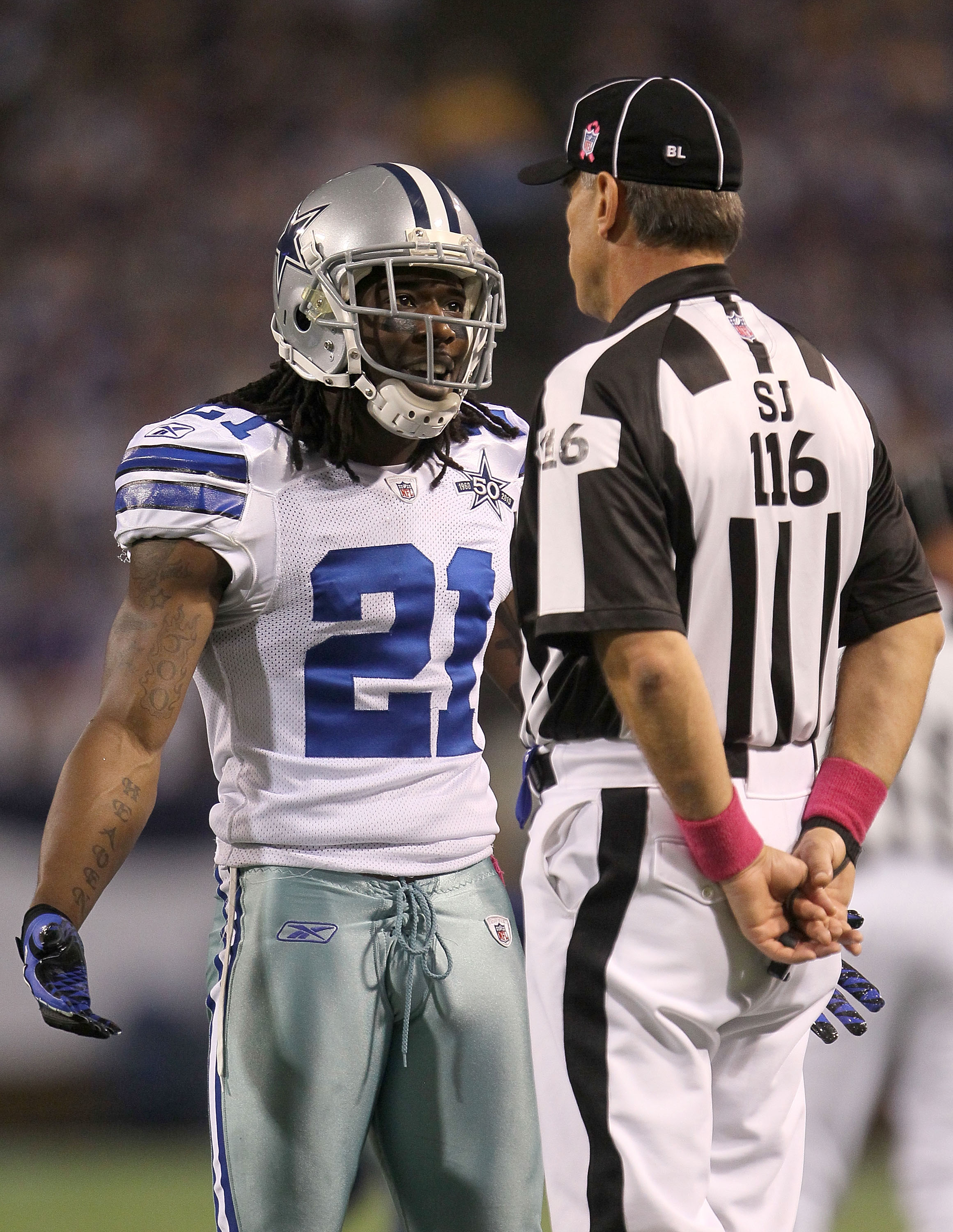 MINNEAPOLIS - OCTOBER 17:  Mike Jenkins #21 of the Dallas Cowboys argues with the referee during the game against the Minnesota Vikings at Mall of America Field on October 17, 2010 in Minneapolis, Minnesota.  (Photo by Jeff Gross/Getty Images)