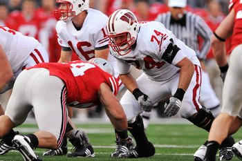COLUMBUS, OH - OCTOBER 10:  Offensive lineman John Moffitt #74 of the Wisconsin Badgers blocks against the Ohio State Buckeyes at Ohio Stadium on October 10, 2009 in Columbus, Ohio.  (Photo by Jamie Sabau/Getty Images)