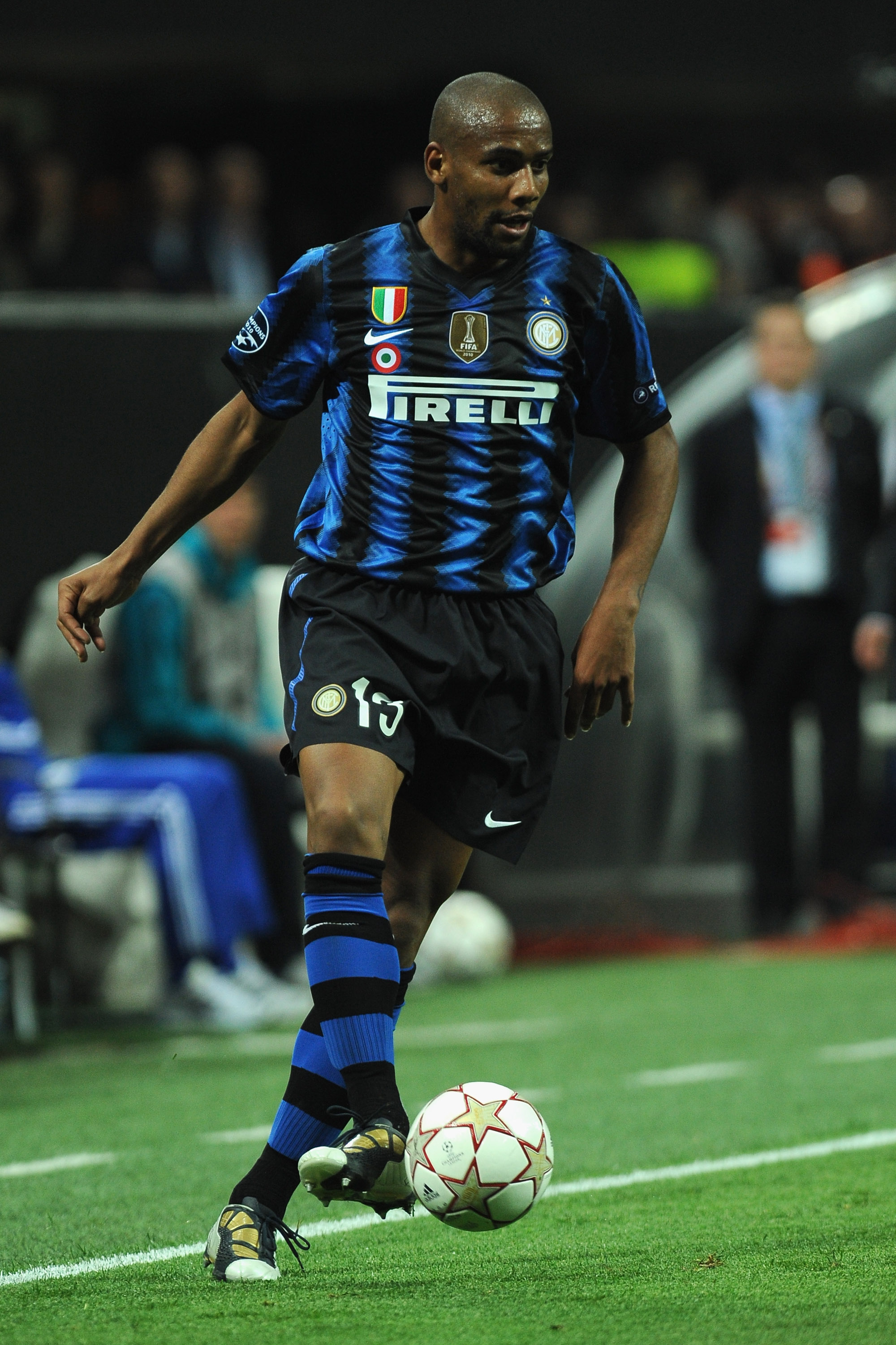 MILAN, ITALY - APRIL 05:  Douglas Maicon of FC Internazionale Milano runs with the ball during the UEFA Champions League Quarter Final match between FC Internazionale Milano and Schalke 04 at San Siro Stadium on April 5, 2011 in Milan, Italy.  (Photo by V