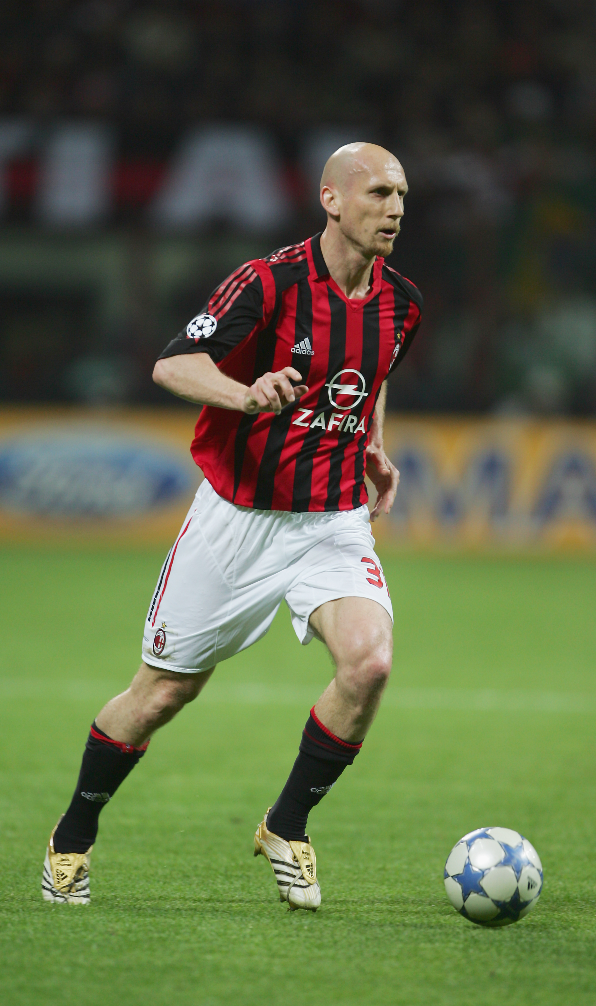 MILAN, ITALY - APRIL 18:  Jaap Stam of Milan in action during the UEFA Champions League Semi Final between AC Milan and Barcelona at the San Siro stadium on April 18, 2006 in Milan, Italy.  (Photo by Mike Hewitt/Getty Images)