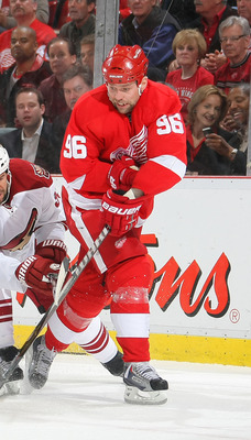 DETROIT,MI- APRIL 13:  Tomas Holmstrom #96 of the Detroit Red Wings attempts a wrap around on Ilya Bryzgalov #30 of the Phoenix Coyotes while Adrian Aucoin #33 of the Phoenix Coyotes defends in Game One of the Western Conference Quarterfinals during the 2