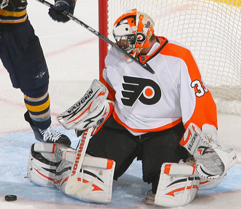 BUFFALO, NY - APRIL 18: Braydon Coburn #5 and Brian Boucher of the Philadelphia Flyers defend against Paul Gaustad #28  of the Buffalo Sabres  in Game Three of the Eastern Conference Quarterfinals during the 2011 NHL Stanley Cup Playoffs at HSBC Arena at