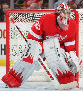 DETROIT, MI- APRIL 13:  Jimmy Howard #35 of the Detroit Red Wings keeps an eye on play against the Phoenix Coyotes in Game One of the Western Conference Quarterfinals during the 2011 NHL Stanley Cup Playoffs at Joe Louis Arena on April 13, 2011 in Detroit