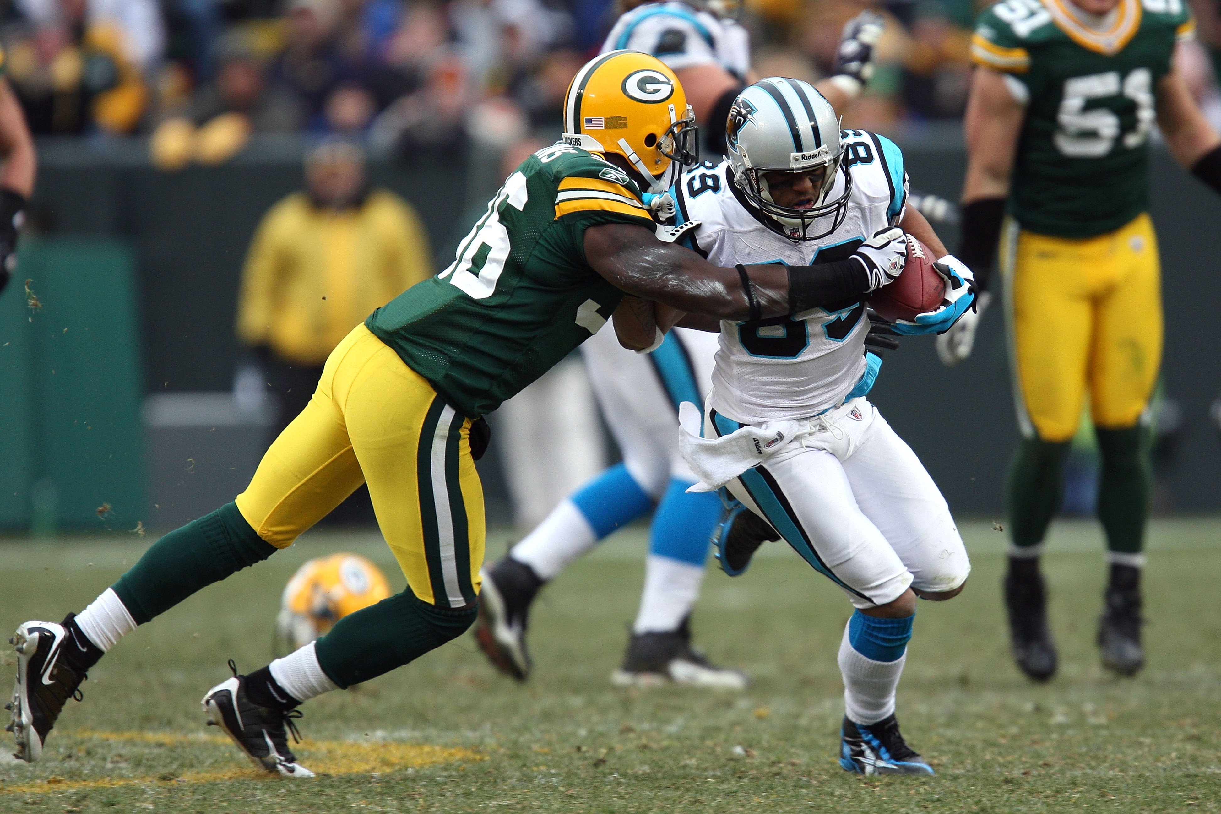 GREEN BAY, WI - NOVEMBER 30:  Steve Smith #89 of  the Carolina Panthers runs for yards after the catch against Nick Collins #36 of the Green Bay Packers at Lambeau Field on November 30, 2008 in Green Bay, Wisconsin. The Panthers won 35-31.  (Photo by Jona