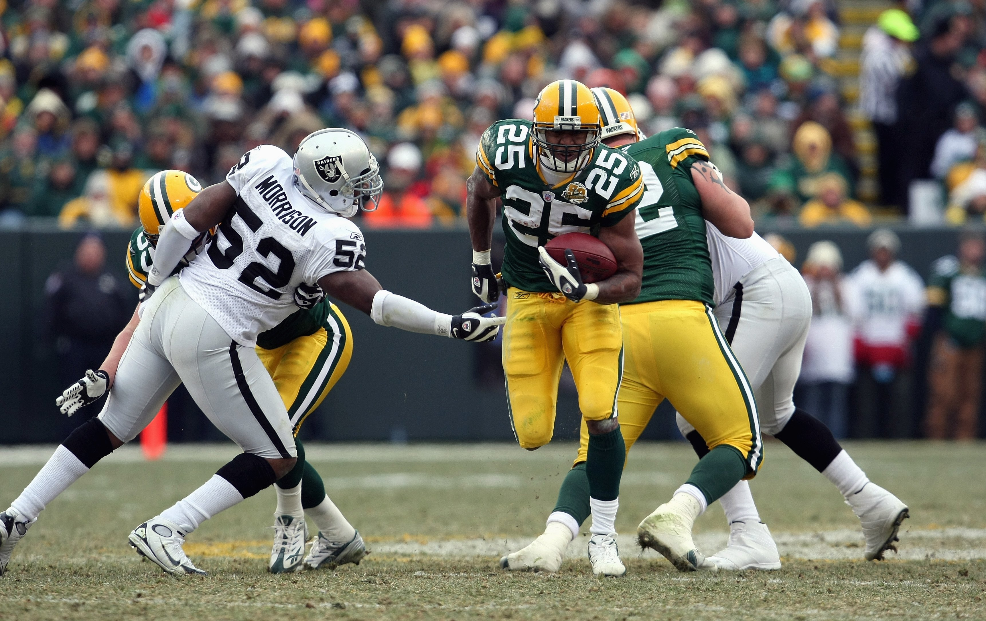GREEN BAY, WI - DECEMBER 09: Ryan Grant #25 of the Green Bay Packers carries the ball against the Oakland Raiders on December 9, 2007 at Lambeau Field in Green Bay, Wisconsin. The Packers defeated the Raiders 38-7 to win the NFC North Division title. (Pho