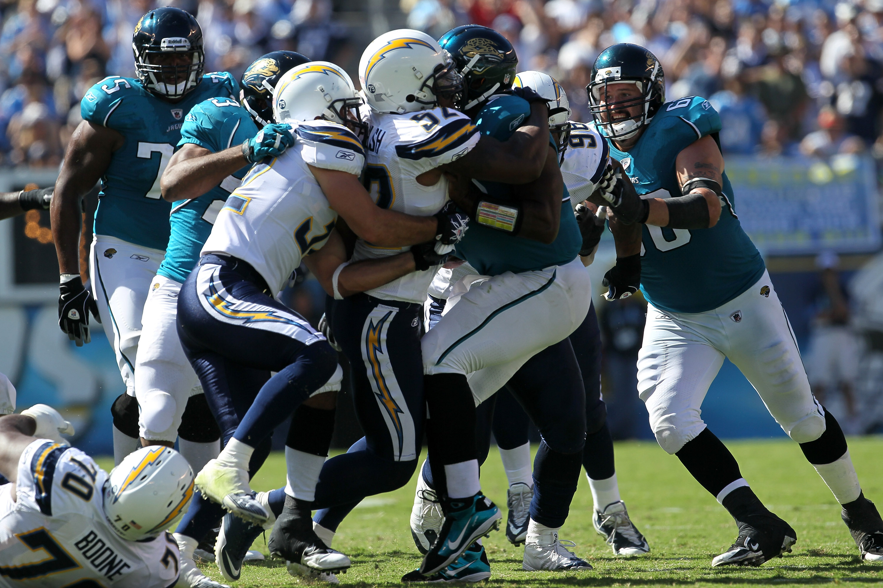 SAN DIEGO - SEPTEMBER 19:  Quarterback David Garrard #9 of the Jacksonville Jaguars is sacked by linebacker Larry English #52 and safety Eric Weddle #32 of the San Diego Chargers at Qualcomm Stadium on September 19, 2010 in San Diego, California.   The Ch