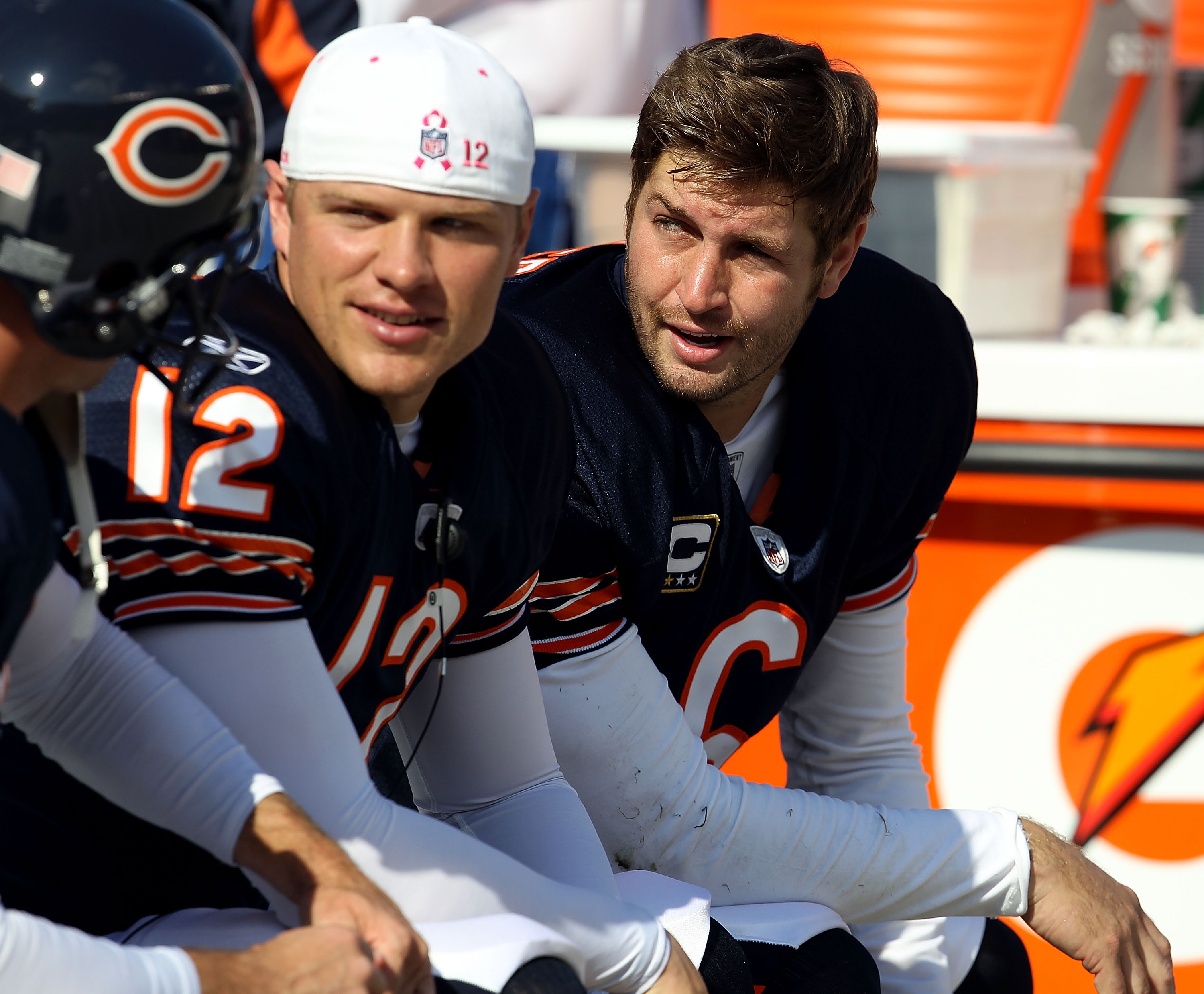CHICAGO - OCTOBER 24: Jay Cutler #6 of the Chicago Bears talks with teammates including Caleb Hanie #12 on the bench during a game against the Washington Redskins at Soldier Field on October 24, 2010 in Chicago, Illinois. The Redskins defeated the Bears 1