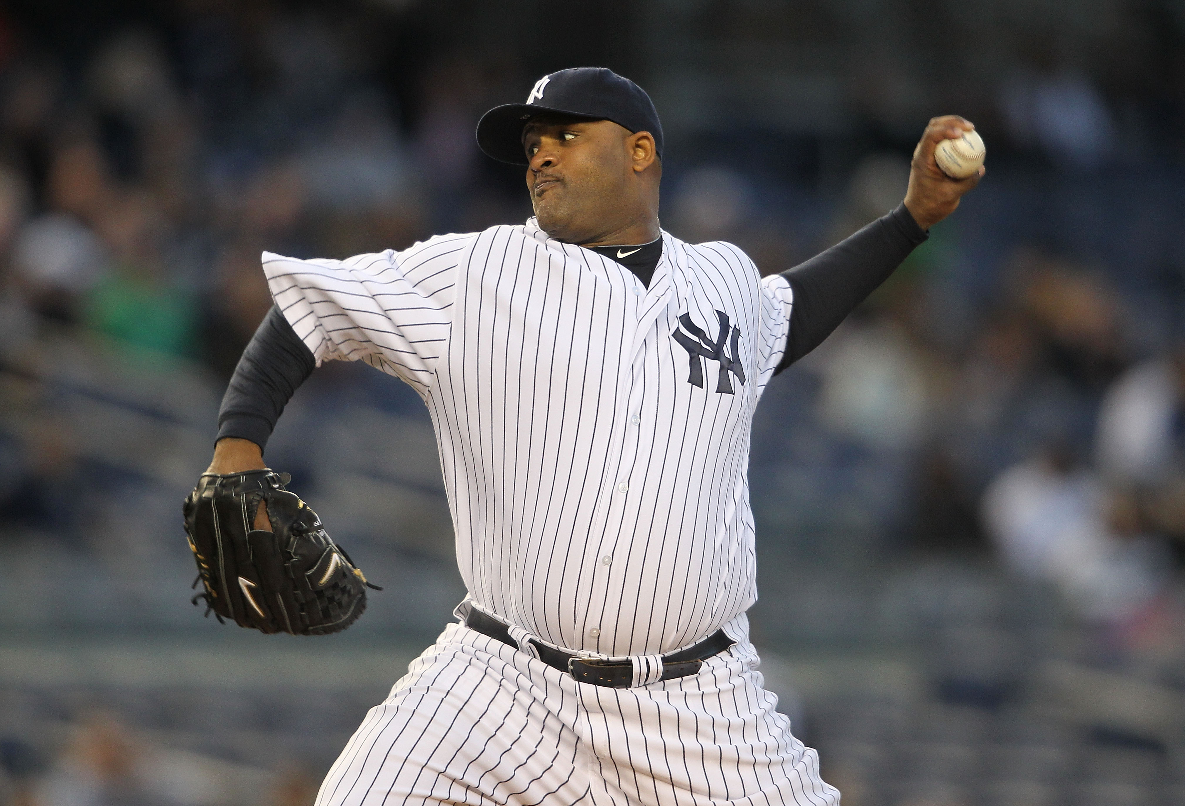 NEW YORK, NY - APRIL 05:  CC Sabathia #52 of the New York Yankees pitches against the Minnesota Twins at Yankee Stadium on April 5, 2011 in the Bronx borough of New York City.  (Photo by Nick Laham/Getty Images)