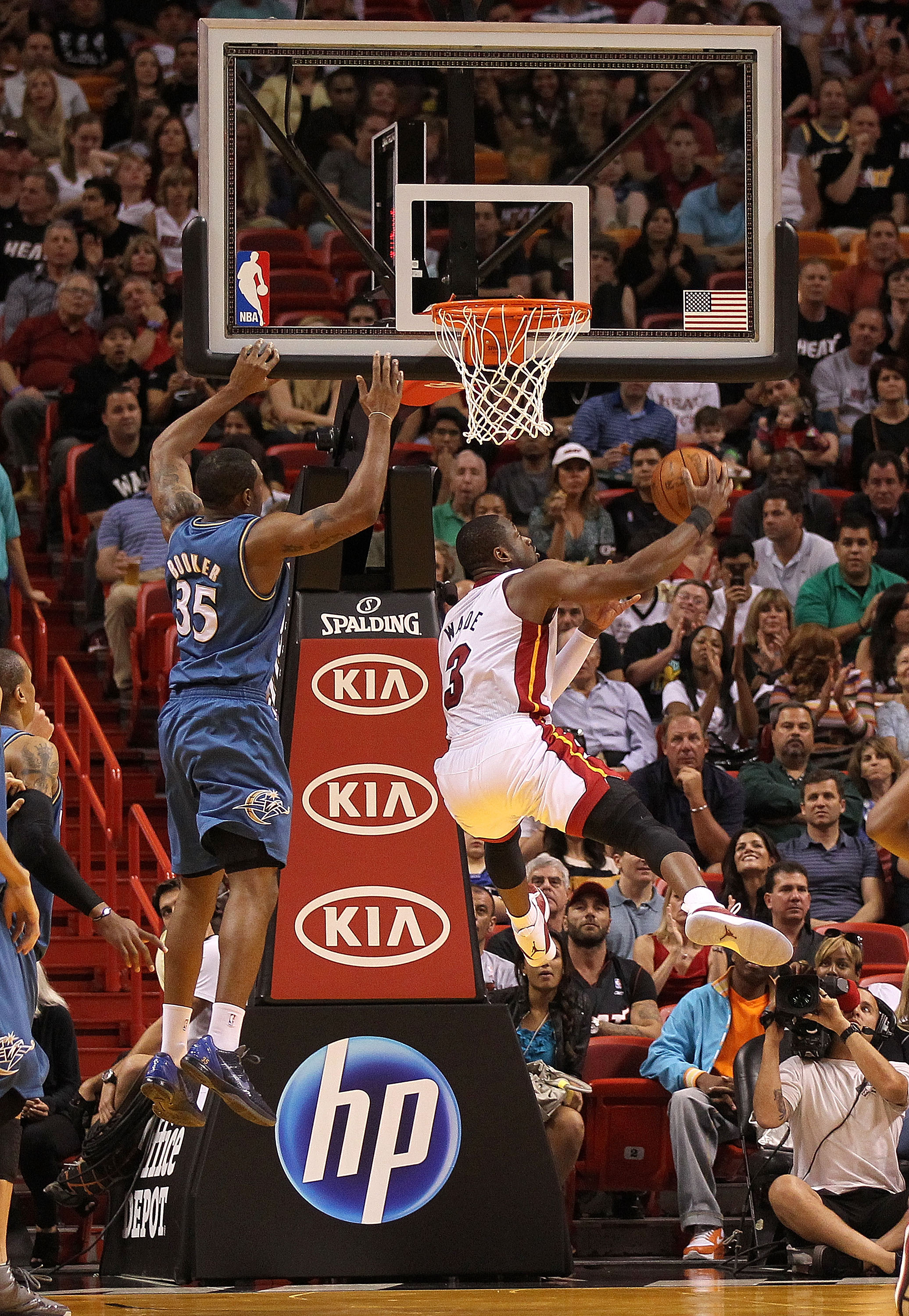 MIAMI, FL - FEBRUARY 25: Dwyane Wade #3 of the Miami Heat takes an off-balance shot during a game against the Washington Wizards at American Airlines Arena on February 25, 2011 in Miami, Florida. NOTE TO USER: User expressly acknowledges and agrees that,