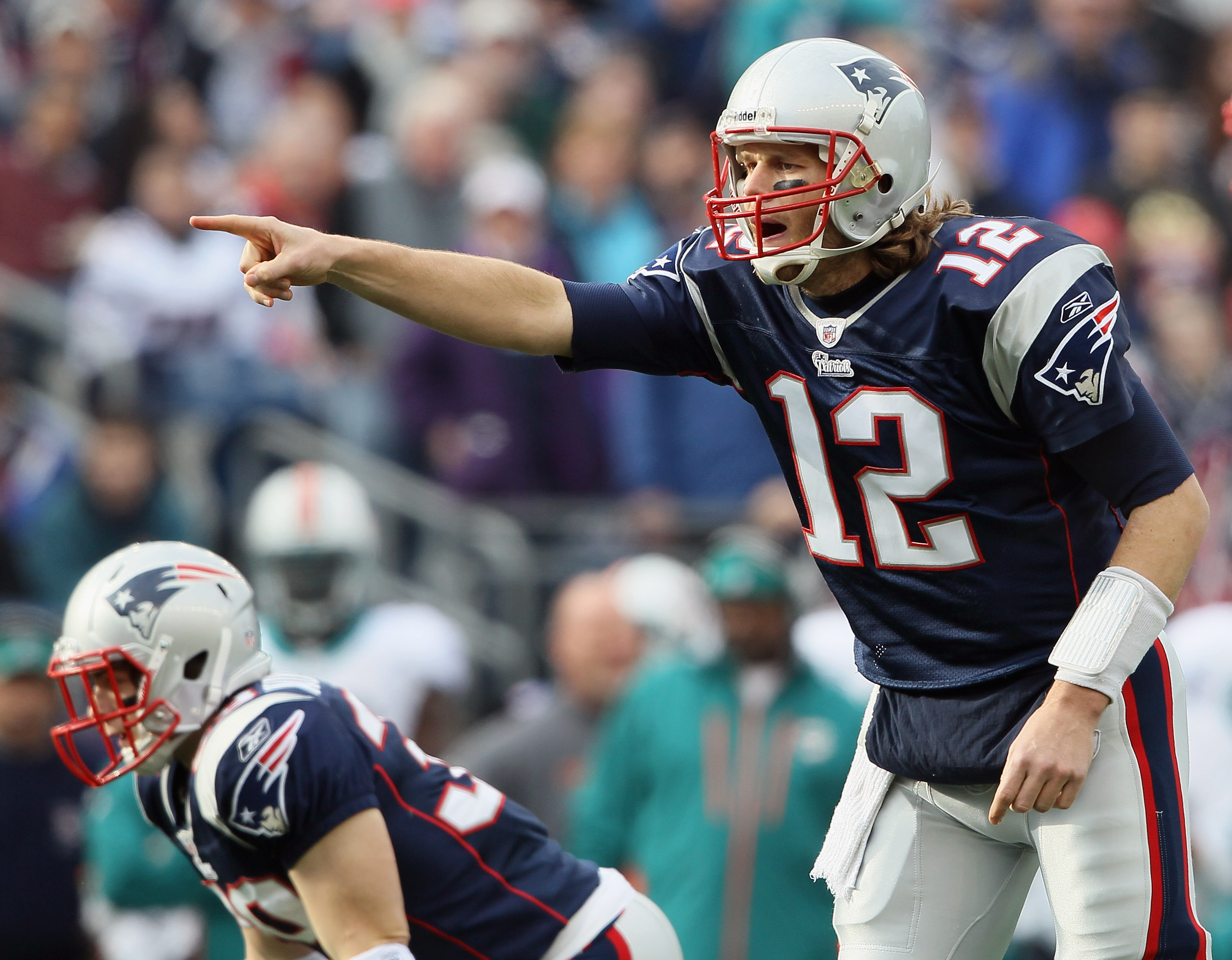 FOXBORO, MA - JANUARY 02:  Tom Brady #12 of the New England Patriots calls out the play in the first half against the Miami Dolphins on January 2, 2011 at Gillette Stadium in Foxboro, Massachusetts.  (Photo by Elsa/Getty Images)