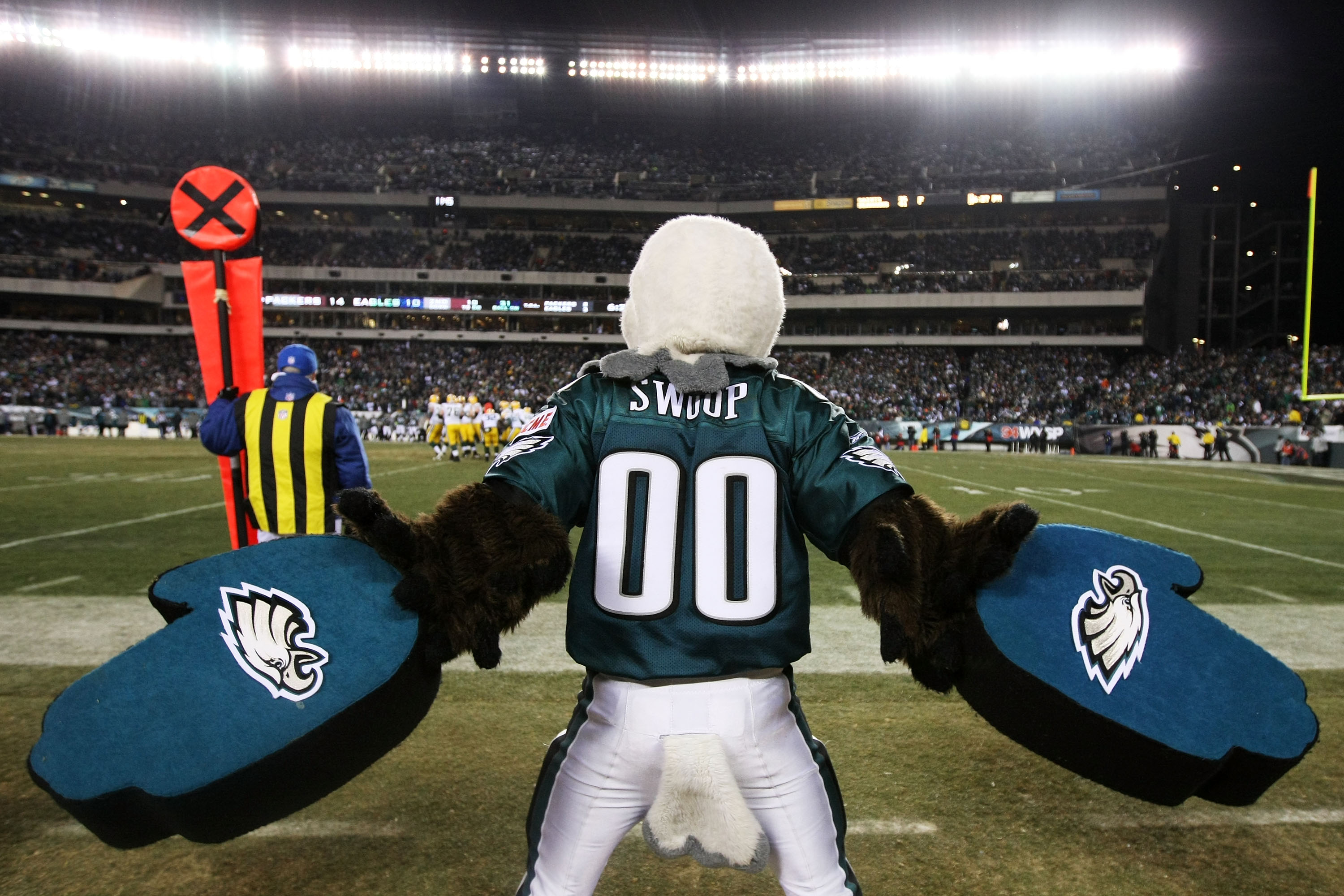 PHILADELPHIA, PA - JANUARY 09:  Philadelphia Eagles mascot Swoop cheers on the sidelines against the Green Bay Packers during the 2011 NFC wild card playoff game at Lincoln Financial Field on January 9, 2011 in Philadelphia, Pennsylvania.  (Photo by Al Be