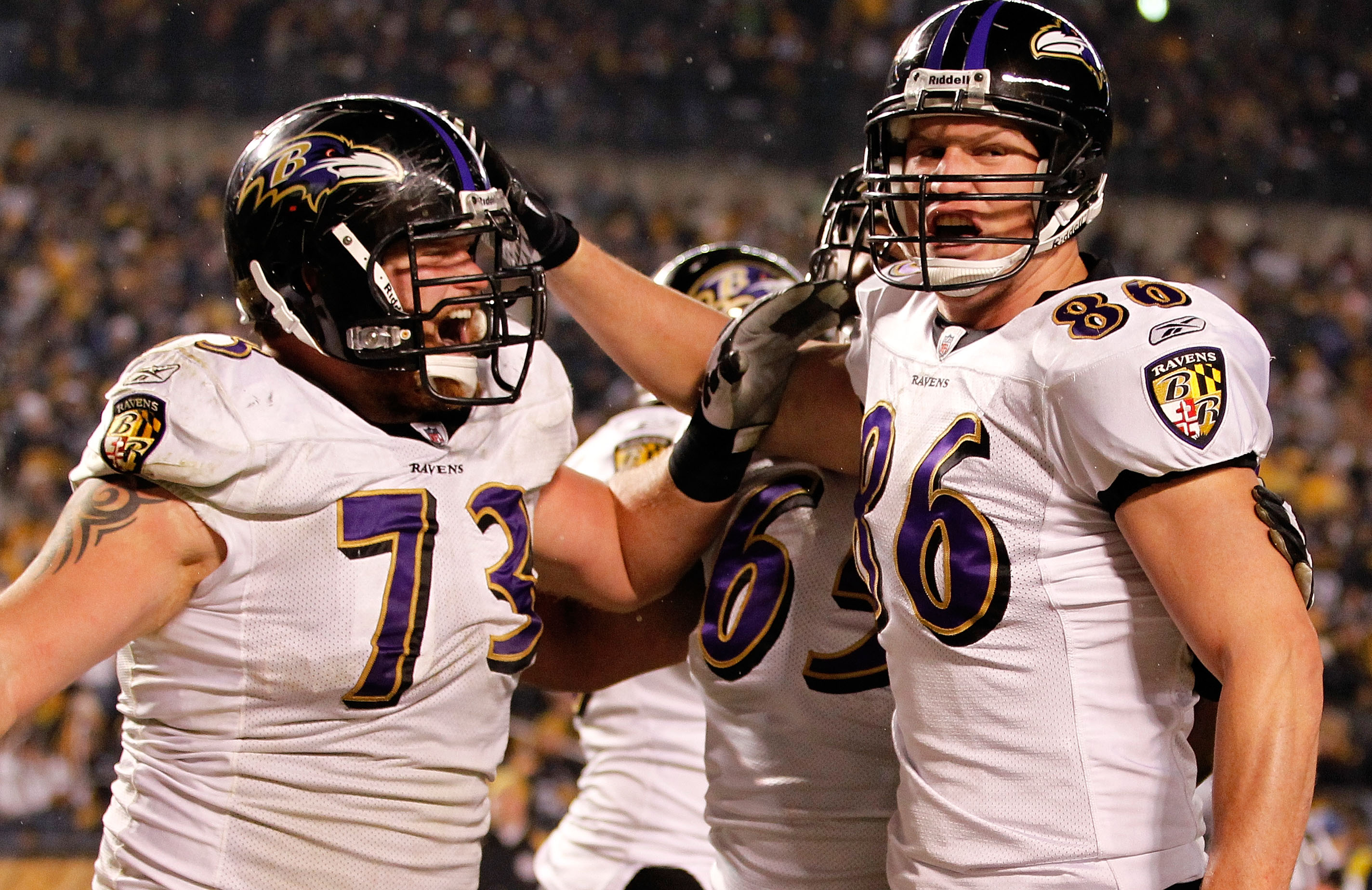 PITTSBURGH, PA - JANUARY 15:  Tight end Todd Heap #86 of the Baltimore Ravens celebrates with teammates after scoring on a four-yard touchdown pass against the Pittsburgh Steelers in the second quarter of the AFC Divisional Playoff Game at Heinz Field on