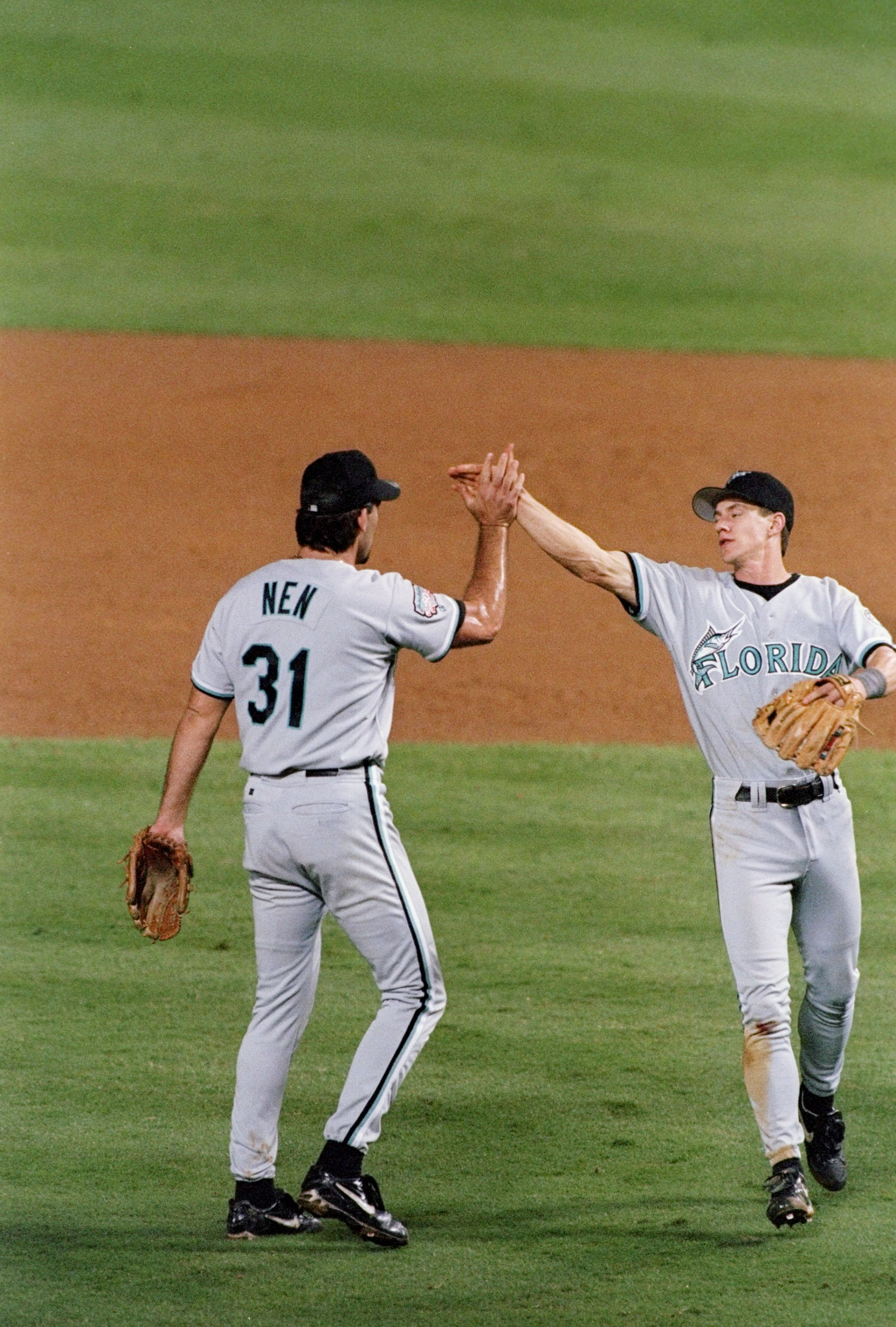 7 Oct 1997: Pitcher Rob Nen (left) and infielder Craig Counsell of the Florida Marlins celebrate during a game against the Atlanta Braves at Turner Field in Atlanta, Georgia. The Marlins won the game, 5-3.