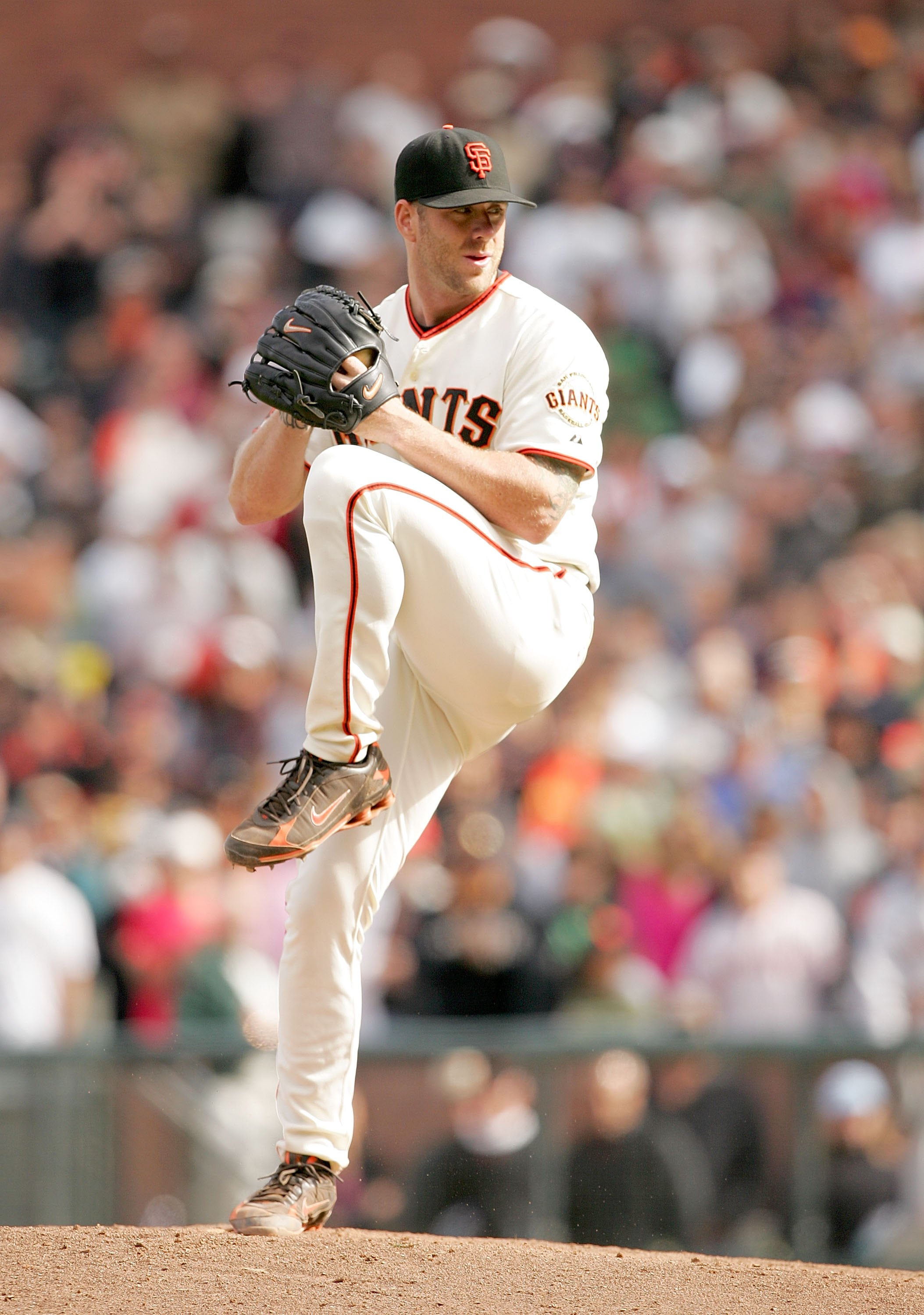 SAN FRANCISCO - AUGUST 30:  Brian Wilson #38 of the San Francisco Giants pitches against the Colorado Rockies at AT&T Park on August 30, 2009 in San Francisco, California.  (Photo by Ezra Shaw/Getty Images)