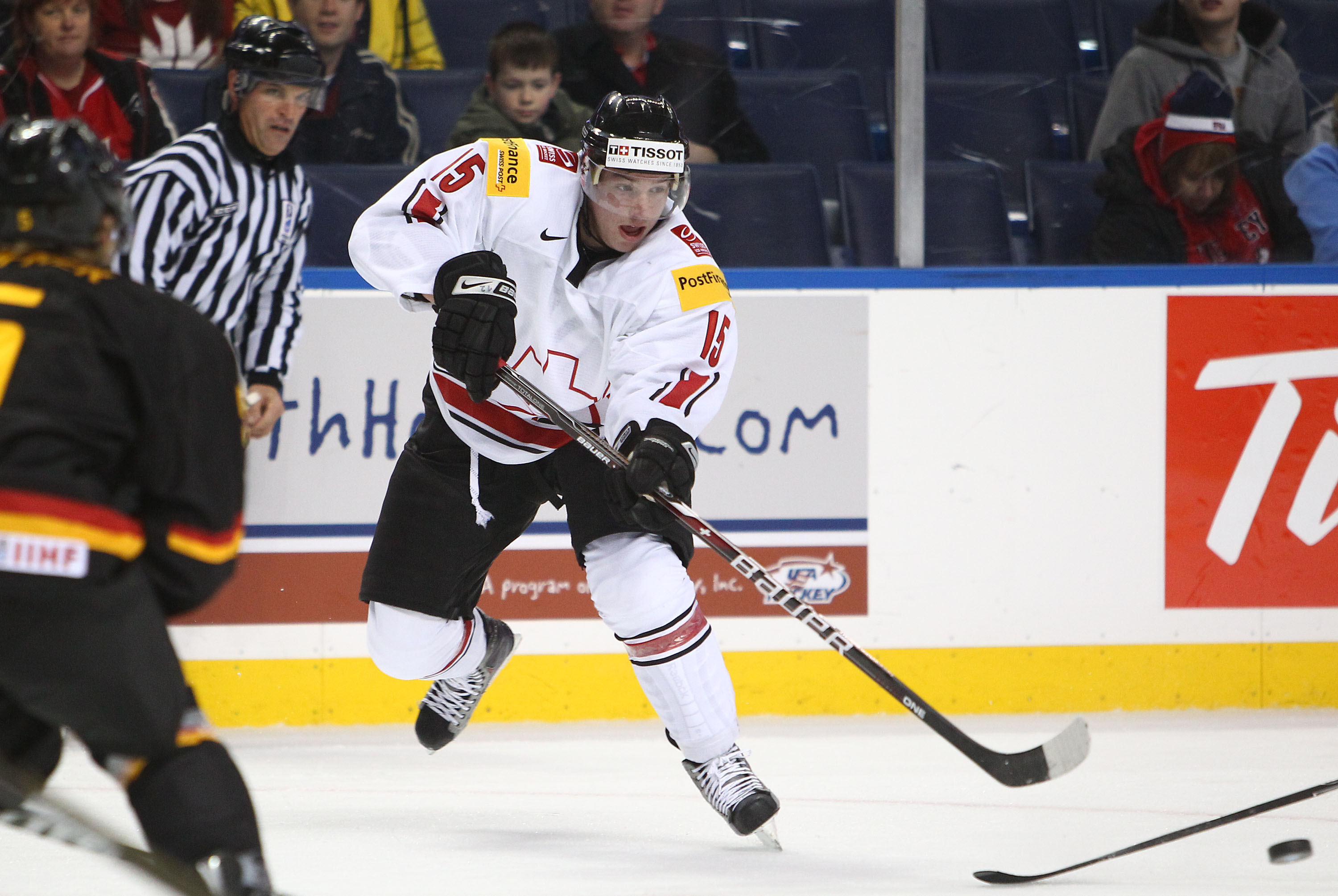 BUFFALO, NY - DECEMBER 26:  Sven Bartschi #15 of Switzerland passes the puck during the 2011 IIHF World U20 Championship Group A game between Germany and Switzerland on December 26, 2010 at HSBC Arena in Buffalo, New York. (Photo by Tom Szczerbowski/Getty