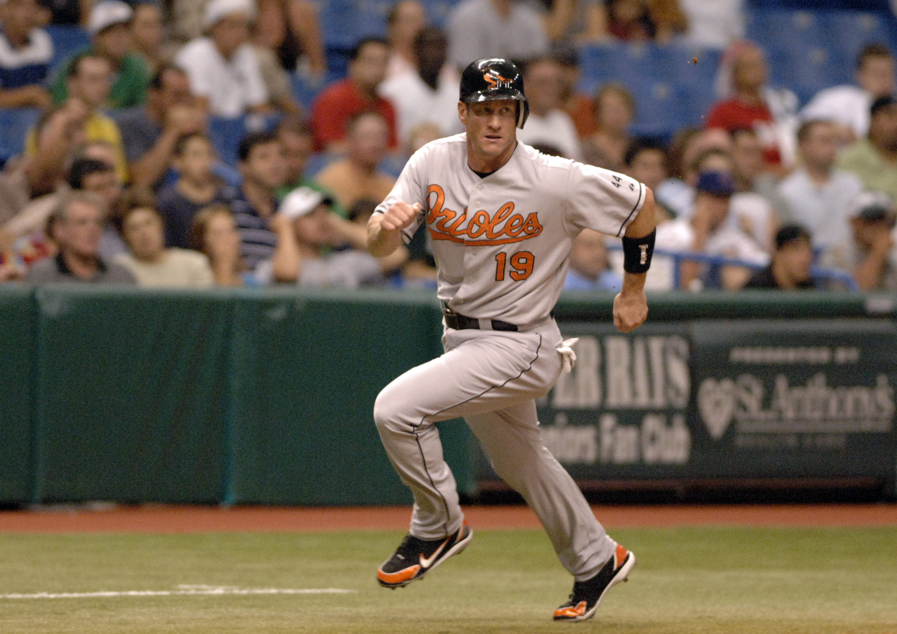 Baltimore Orioles first baseman Jeff Conine rounds third base and scores  against the Tampa Bay Devil Rays at Tropicana Field in St. Petersburg, Florida on July 22, 2006.  (Photo by A. Messerschmidt/Getty Images)