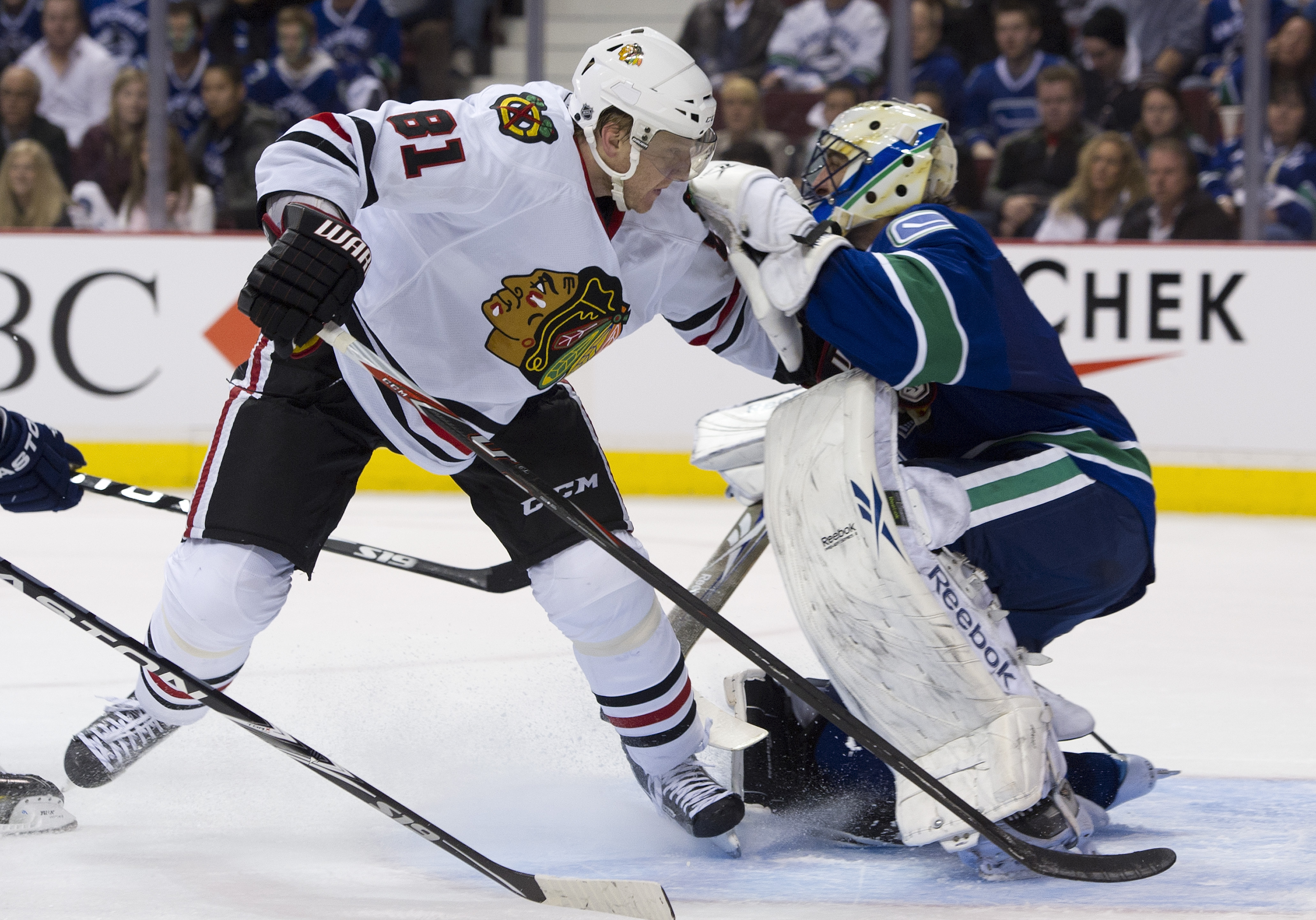 VANCOUVER, CANADA - APRIL 13: Marian Hossa #81 of the Chicago Blackhawks skates into goalie Roberto Luongo #1 after getting pushed during the third period in Game One of the Western Conference Quarterfinals during the 2011 NHL Stanley Cup Playoffs on Apri