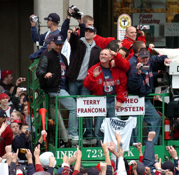 BOSTON - OCTOBER 30:  Fans cheer Boston Red Sox Manager Terry Francona and GM Theo Epstein during the Rolling Rally victory parade October 30, 2004 in Boston, Massachusetts. The Red Sox beat the St. Louis Cardinals in four straight games to take the teams