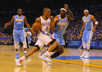 OKLAHOMA CITY, OK - APRIL 17: Russell Westbrook #0 of the Oklahoma City Thunder drives to the basket against Ty Lawson #3 of the Denver Nuggets in Game One of the Western Conference Quarterfinals in the 2011 NBA Playoffs on April 17, 2011 at the Ford Cent