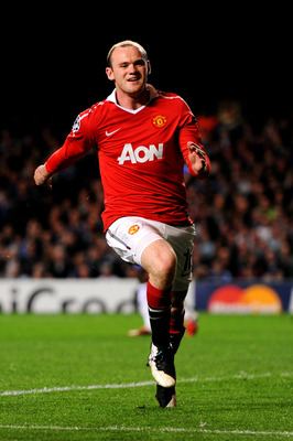 LONDON, ENGLAND - APRIL 06:  Wayne Rooney of Manchester United celebrates after scoring the opening goal during the UEFA Champions League quarter final first leg match between Chelsea and Manchester United at Stamford Bridge on April 6, 2011 in London, En