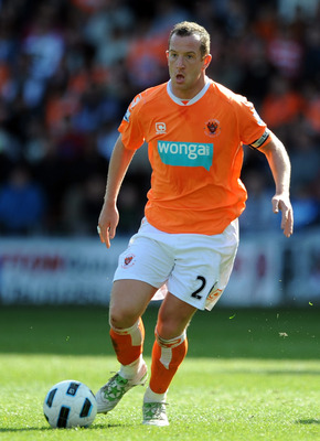 BLACKPOOL, ENGLAND - APRIL 16:  Charlie Adam of Blackpool in action during the Barclays Premier League match between Blackpool and Wigan Athletic at Bloomfield Road on April 16, 2011 in Blackpool, England.  (Photo by Chris Brunskill/Getty Images)