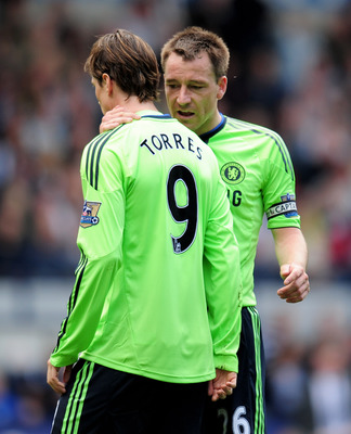 WEST BROMWICH, ENGLAND - APRIL 16:  John Terry of Chelsea talks with team mate Fernando Torres during the Barclays Premier League match between West Bromich Albion and Chelsea at The Hawthorns on April 16, 2011 in West Bromwich, England.  (Photo by Shaun