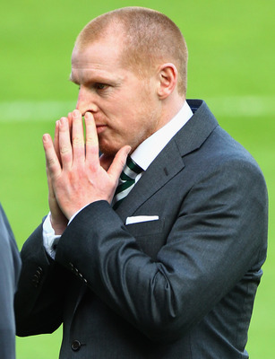 KILMARNOCK, SCOTLAND - APRIL 20:  Celtic coach Neil Lennon walks of the pitch at Kilmarnock on April 20, 2011 in Kilmarnock, Scotland. The head coach of Celtic whose team face Kilmarnock tonight, was at the centre of a police investigation following a par