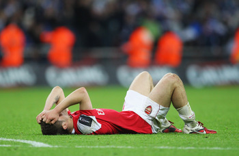 LONDON, ENGLAND - FEBRUARY 27:  Jack Wilshere of Arsenal holds his head in despair after the Carling Cup Final between Arsenal and Birmingham City at Wembley Stadium on February 27, 2011 in London, England.  (Photo by Alex Livesey/Getty Images)