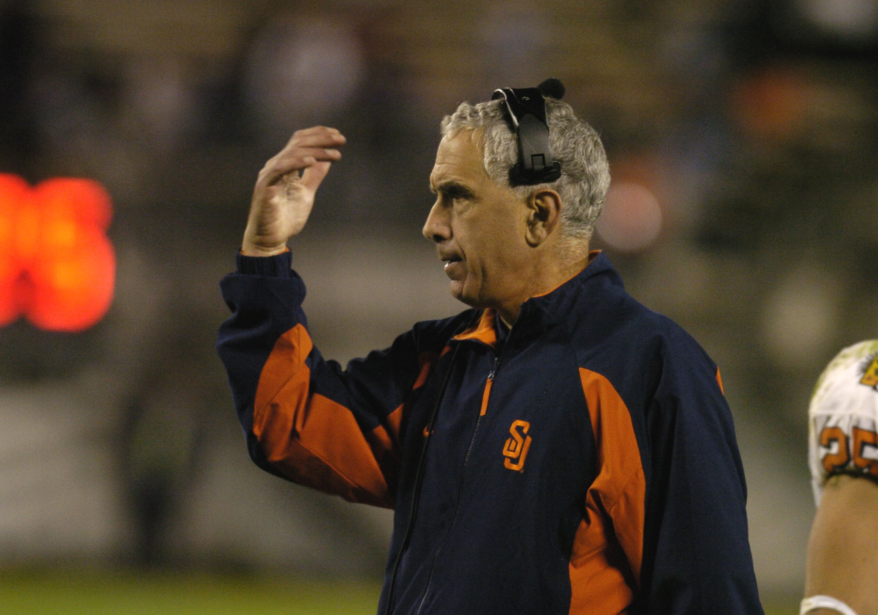 Syracuse coach Paul Pasqualoni directs play  during halftime against  Georgia Tech  in the Champs Sports Bowl at the Florida Citrus Bowl, Orlando, Florida Dec 21, 2004. (Photo by A. Messerschmidt/Getty Images) *** Local Caption ***