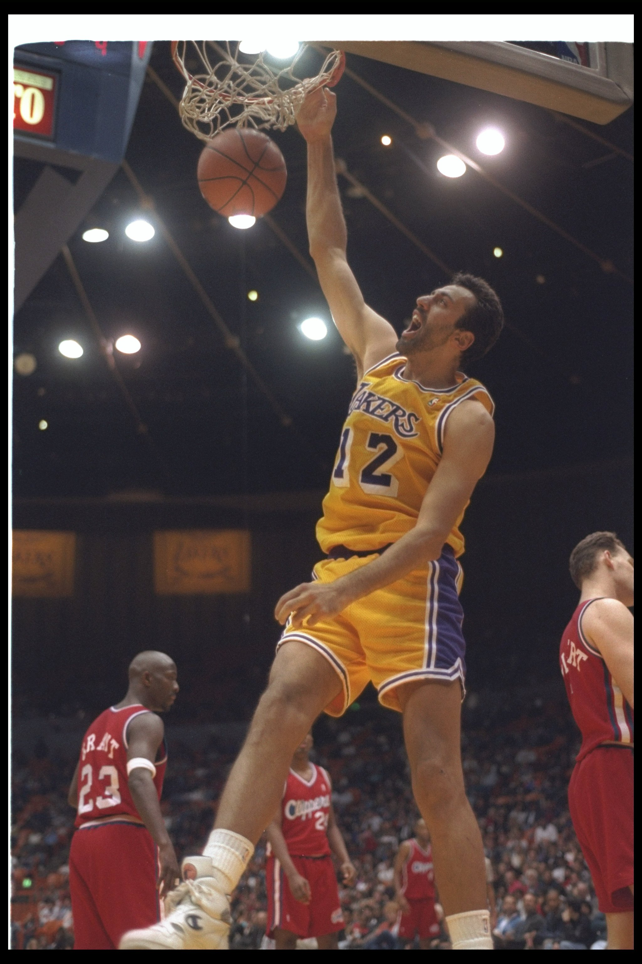 7 Jan 1994:  Center Vlade Divac of the Los Angeles Lakers sinks the ball during a game against the Los Angeles Clippers at the Great Western Forum in Inglewood, California.  The Lakers won the game, 111-108. Mandatory Credit: Stephen Dunn  /Allsport Manda