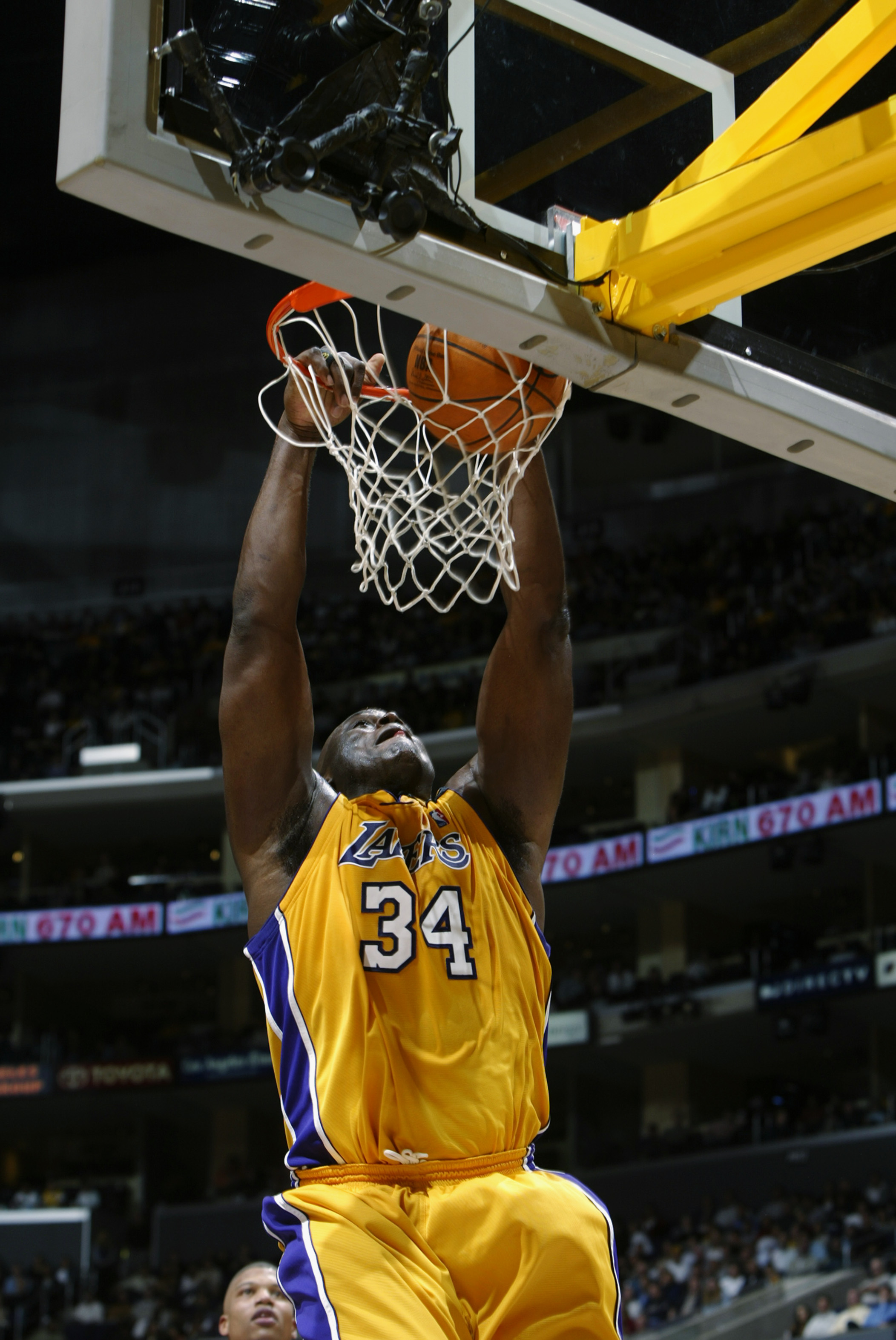 LOS ANGELES - DECEMBER 3:  Shaquille O'Neal #34 of the Los Angeles Lakers slam dunks during the game against the Memphis Grizzlies at Staples Center on December 3, 2002 in Los Angeles, California.  The Lakers won 101-91.  NOTE TO USER: User expressly ackn
