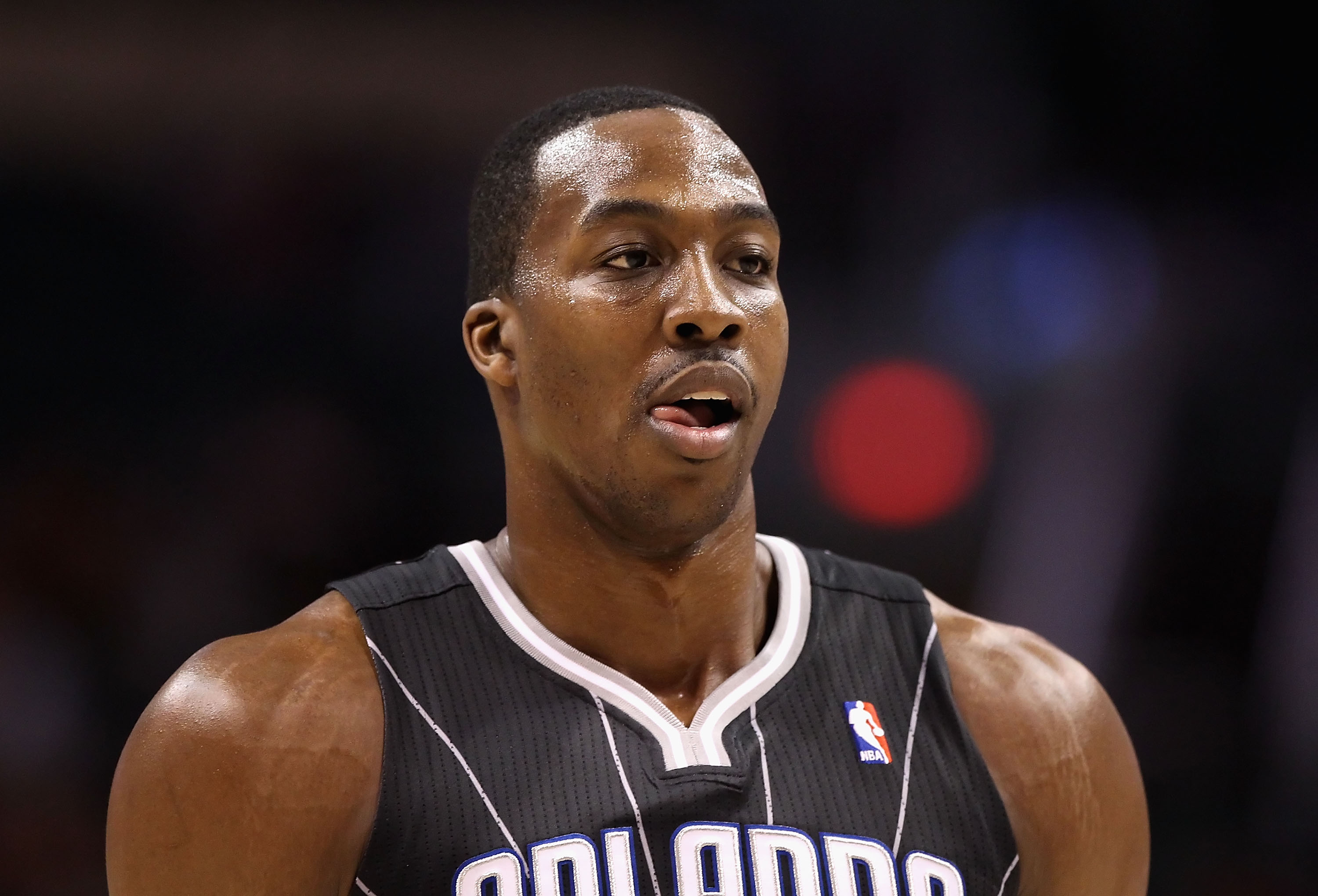 PHOENIX, AZ - MARCH 13:  Dwight Howard #12 of the Orlando Magic during the NBA game against the Phoenix Suns at US Airways Center on March 13, 2011 in Phoenix, Arizona. The Magic defeated the Suns 111-88. NOTE TO USER: User expressly acknowledges and agre