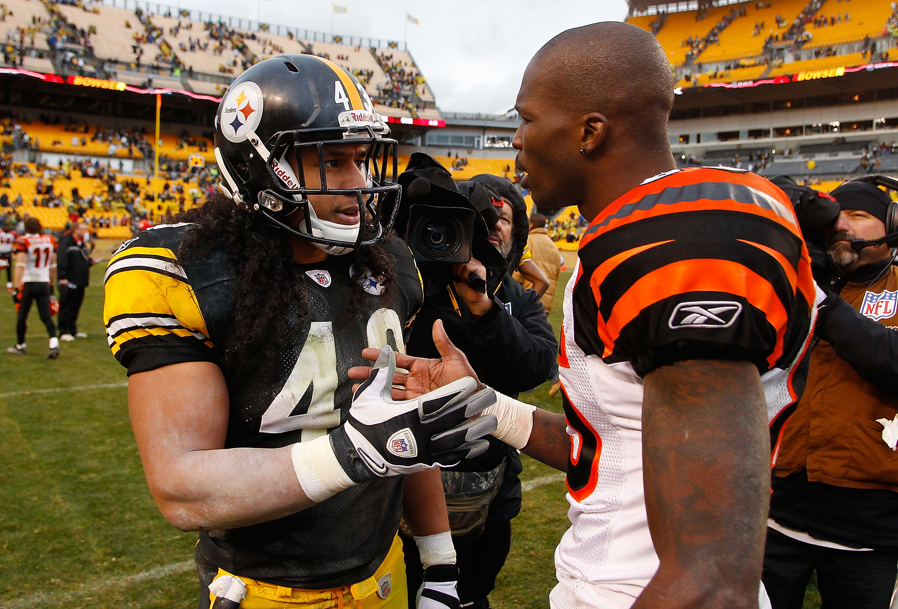 PITTSBURGH - DECEMBER 12:  Troy Polamalu #43 of the Pittsburgh Steelers talks with Chad Ochocinco #85 of the Cincinnati Bengals following the game on December 12, 2010 at Heinz Field in Pittsburgh, Pennsylvania.  (Photo by Jared Wickerham/Getty Images)