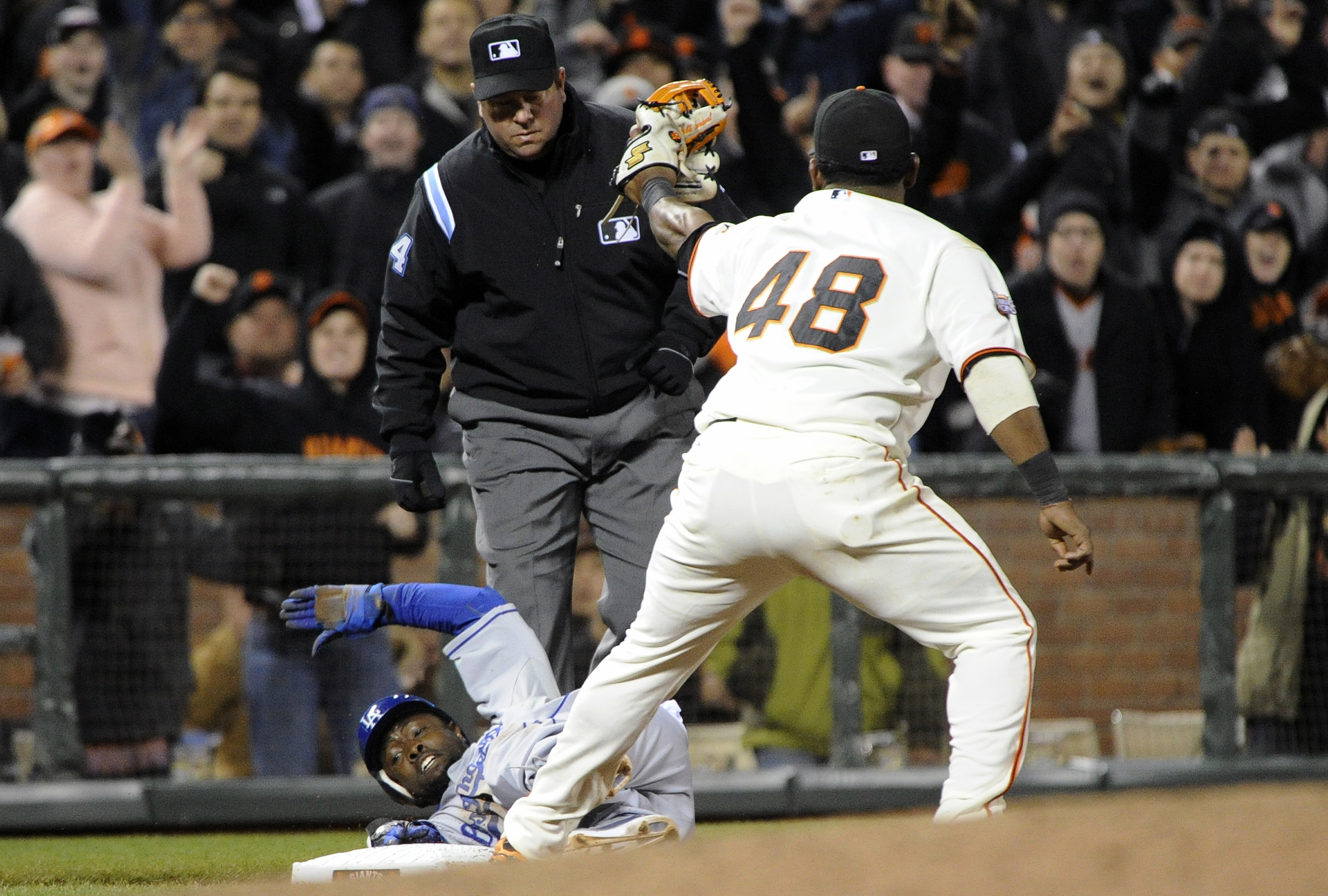SAN FRANCISCO, CA - APRIL 13: Pablo Sandoval #48 of the San Francisco Giants shows third base umpire Sam Holbrook the ball after tagging out Tony Gwynn Jr. #10 of the Los Angeles Dodgers during a MLB baseball game at AT&T Park April 13, 2011 in San Franci
