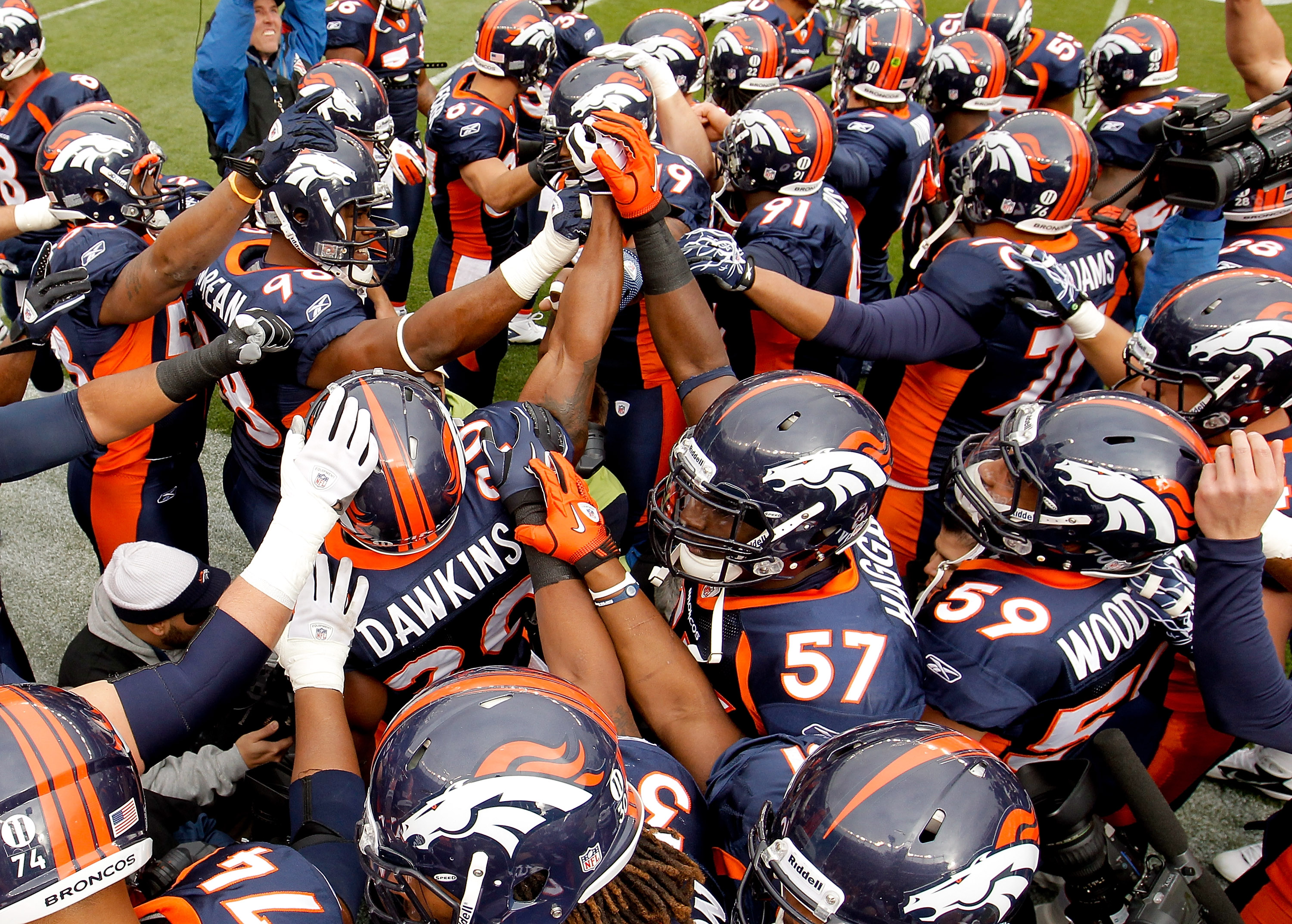DENVER - NOVEMBER 28:  The Denver Broncos gather together before taking on the St. Louis Rams at INVESCO Field at Mile High on November 28, 2010 in Denver, Colorado. (Photo by Justin Edmonds/Getty Images)