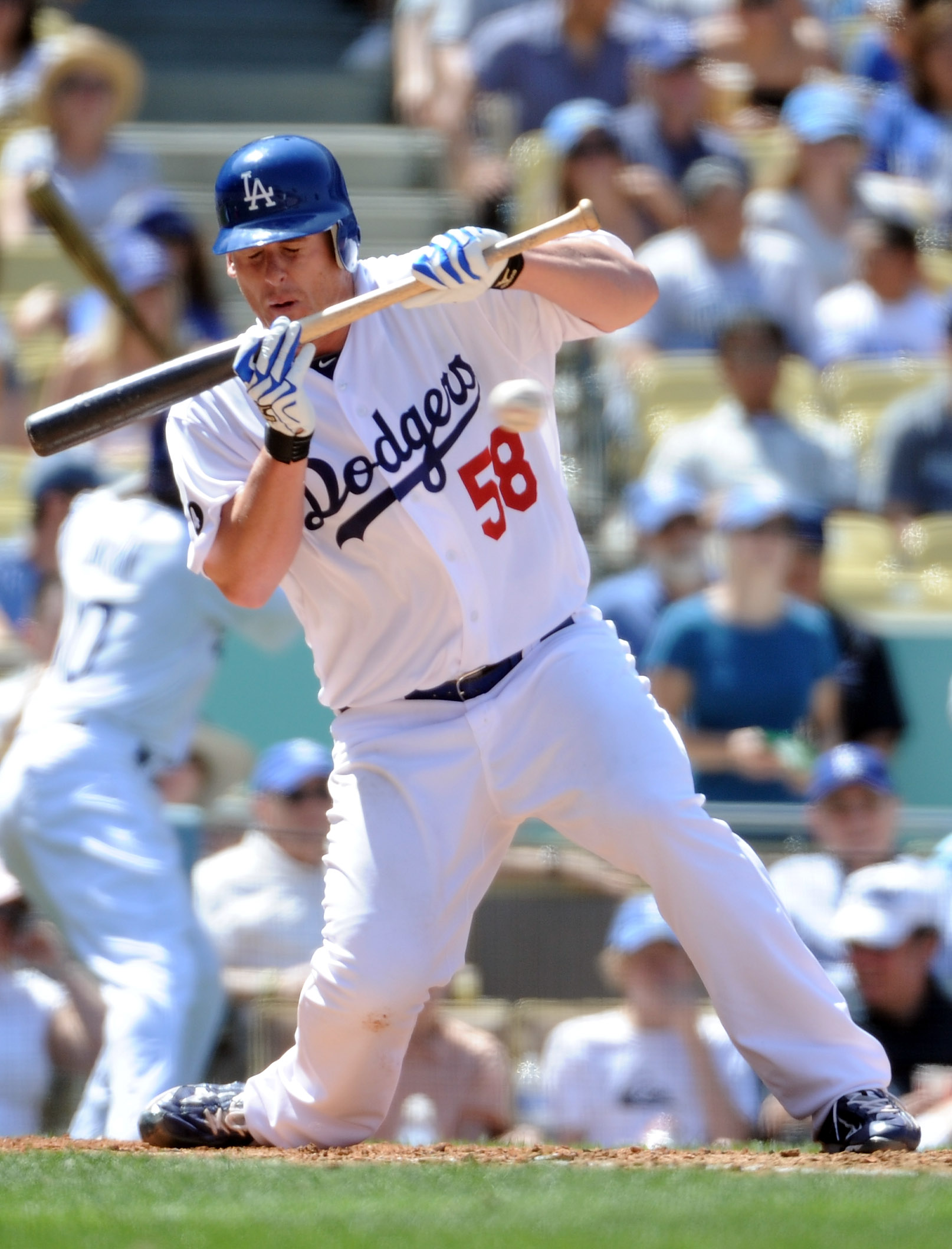 LOS ANGELES, CA - APRIL 17:  Chad Billingsley #58 of the Los Angeles Dodgers turns away from an inside pitch in an attempted bunt during the fourth inning against the St Louis Cardinals at Dodger Stadium on April 17, 2011 in Los Angeles, California.  (Pho
