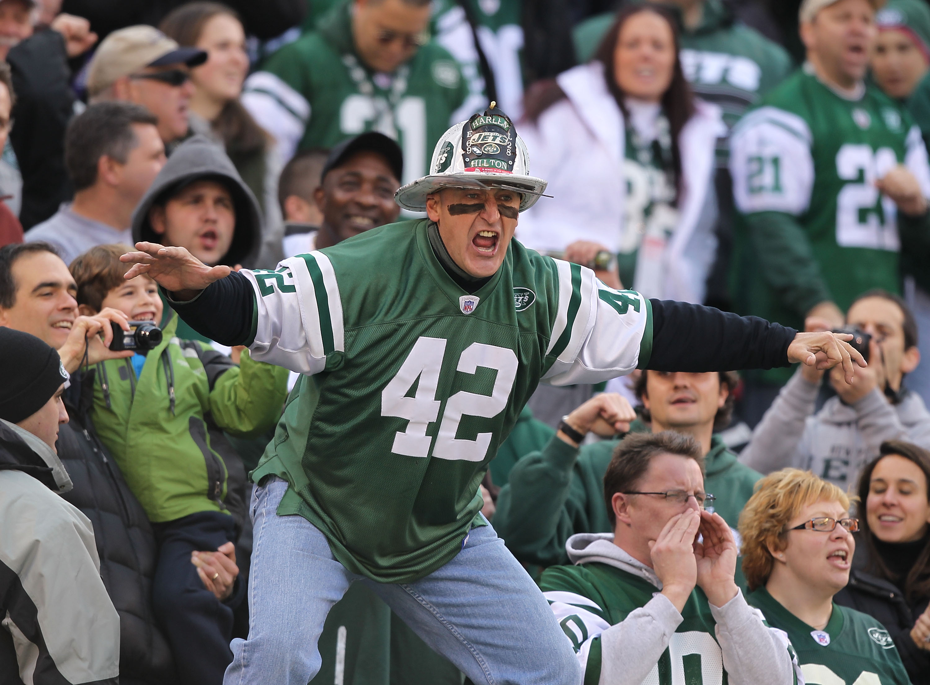 EAST RUTHERFORD, NJ - NOVEMBER 21:  Ed Anzalone, alias Fireman Eddie,  super fan of the New York Jets leads a cheer against the Houston Texans during their  game on November21, 2010 at the New Meadowlands Stadium  in East Rutherford, New Jersey.  (Photo b