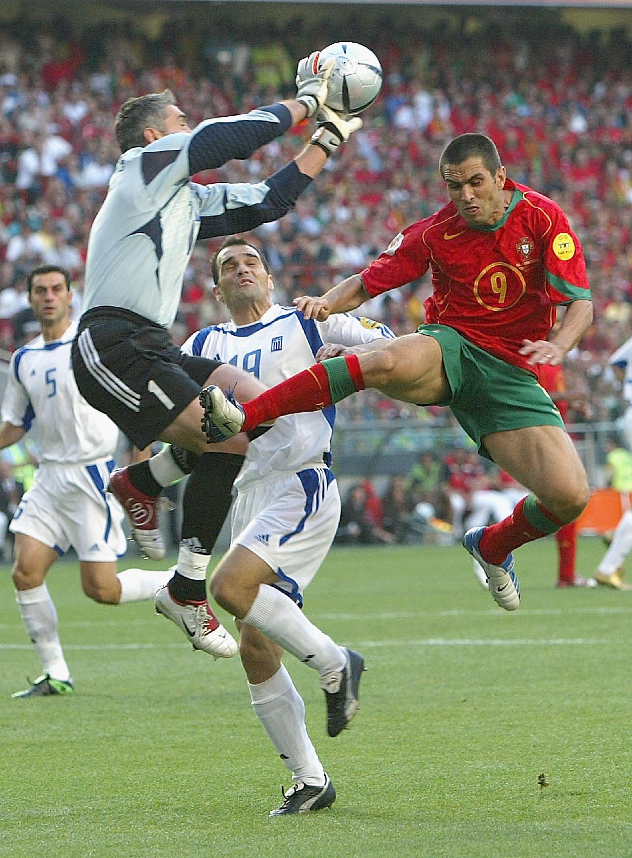 Antonios Nikopolidis beats Pauleta to the ball in the Euro 2004 final