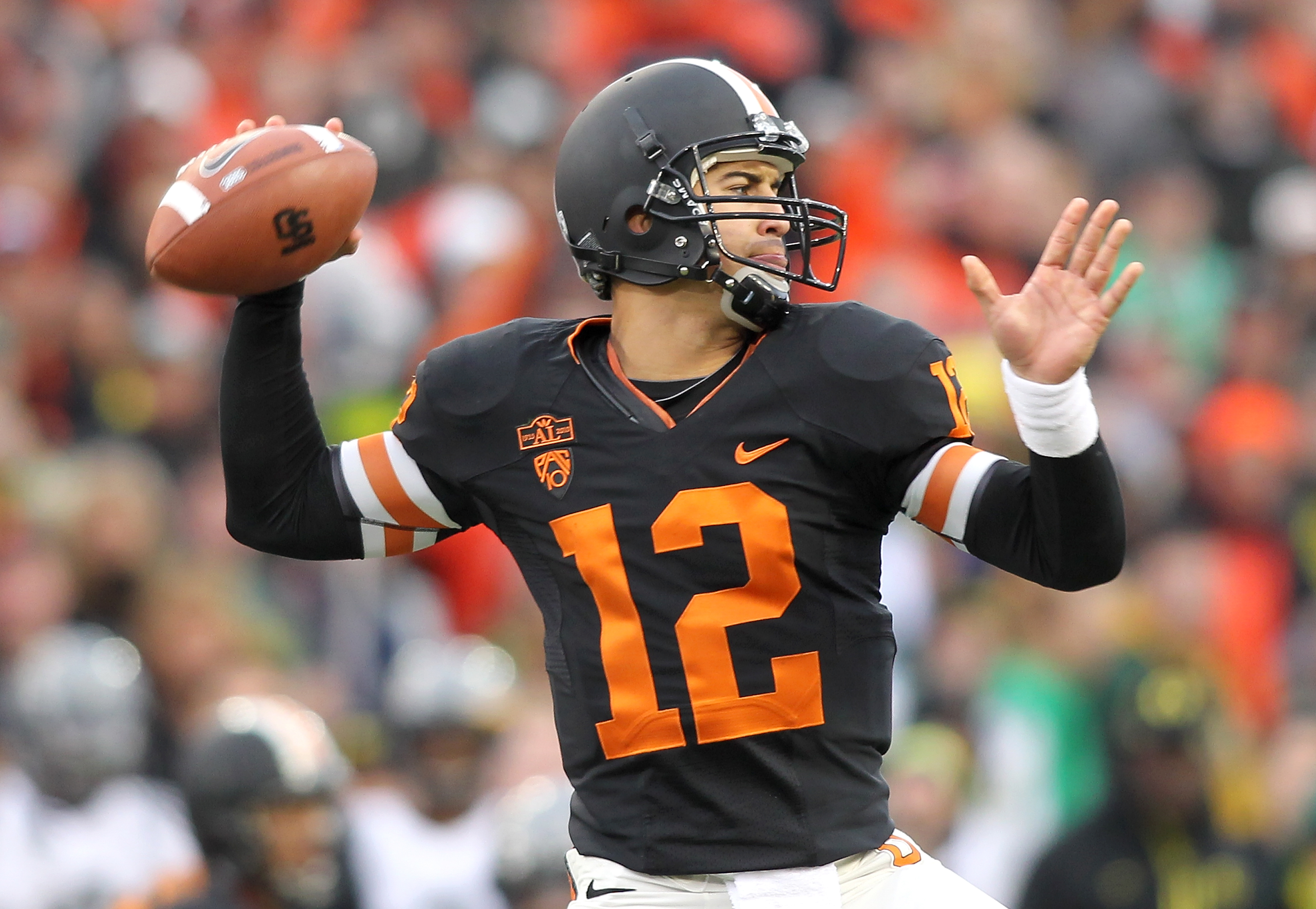 CORVALLIS, OR - DECEMBER 04:  Quarterback Ryan Katz #12 of the Oregon State Beavers throws a pass against the Oregon Ducks during the 114th Civil War on December 4, 2010 at the Reser Stadium in Corvallis, Oregon.  (Photo by Jonathan Ferrey/Getty Images)