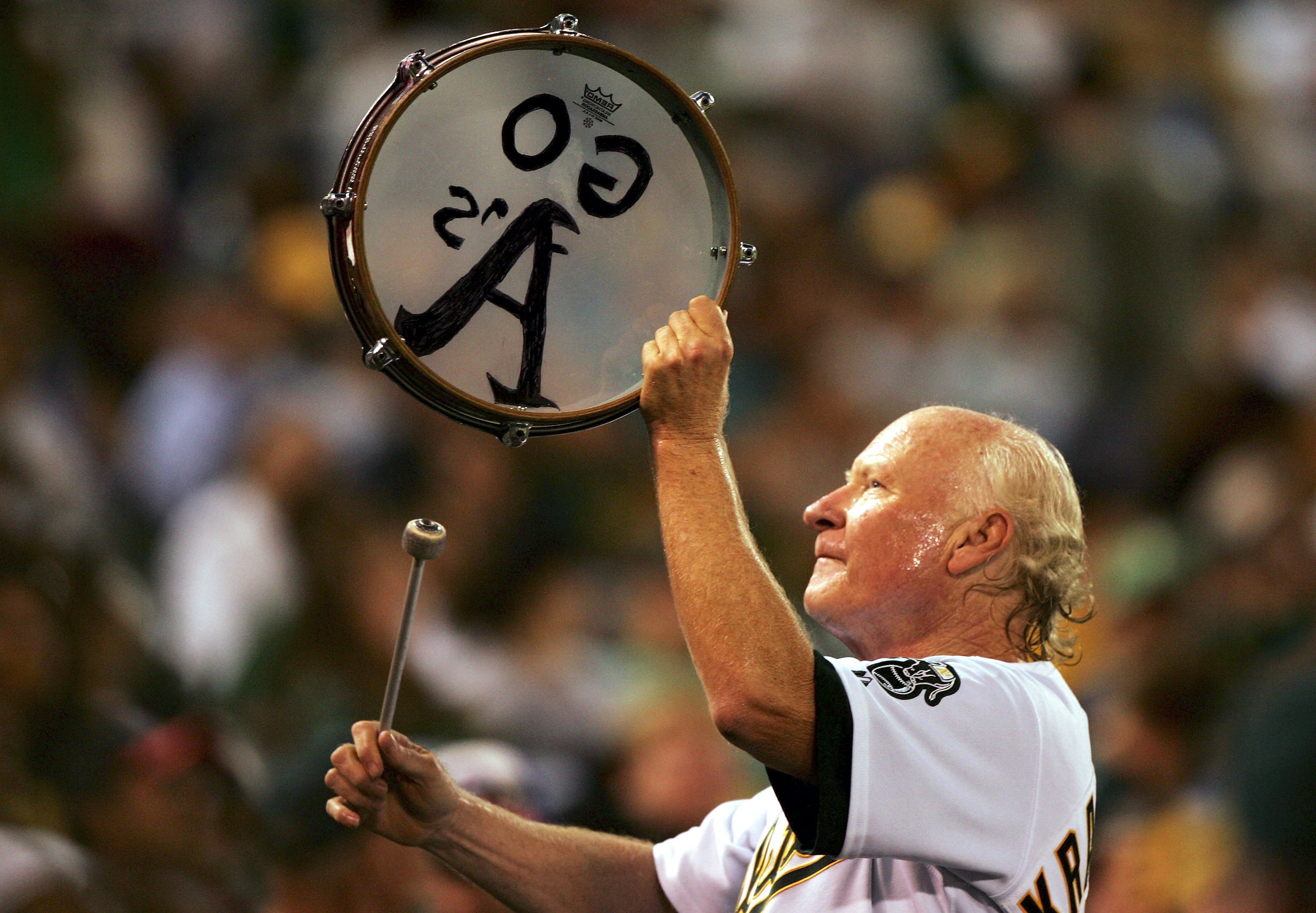 OAKLAND, CA - SEPTEMBER 22:  A's fan 'Krazy' George Henderson cheers during the Los Angeles Angels of Anaheim and Oakland Athletics MLB game at McAfee Coliseum on September 22, 2006 in Oakland, California.  (Photo by Jed Jacobsohn/Getty Images)