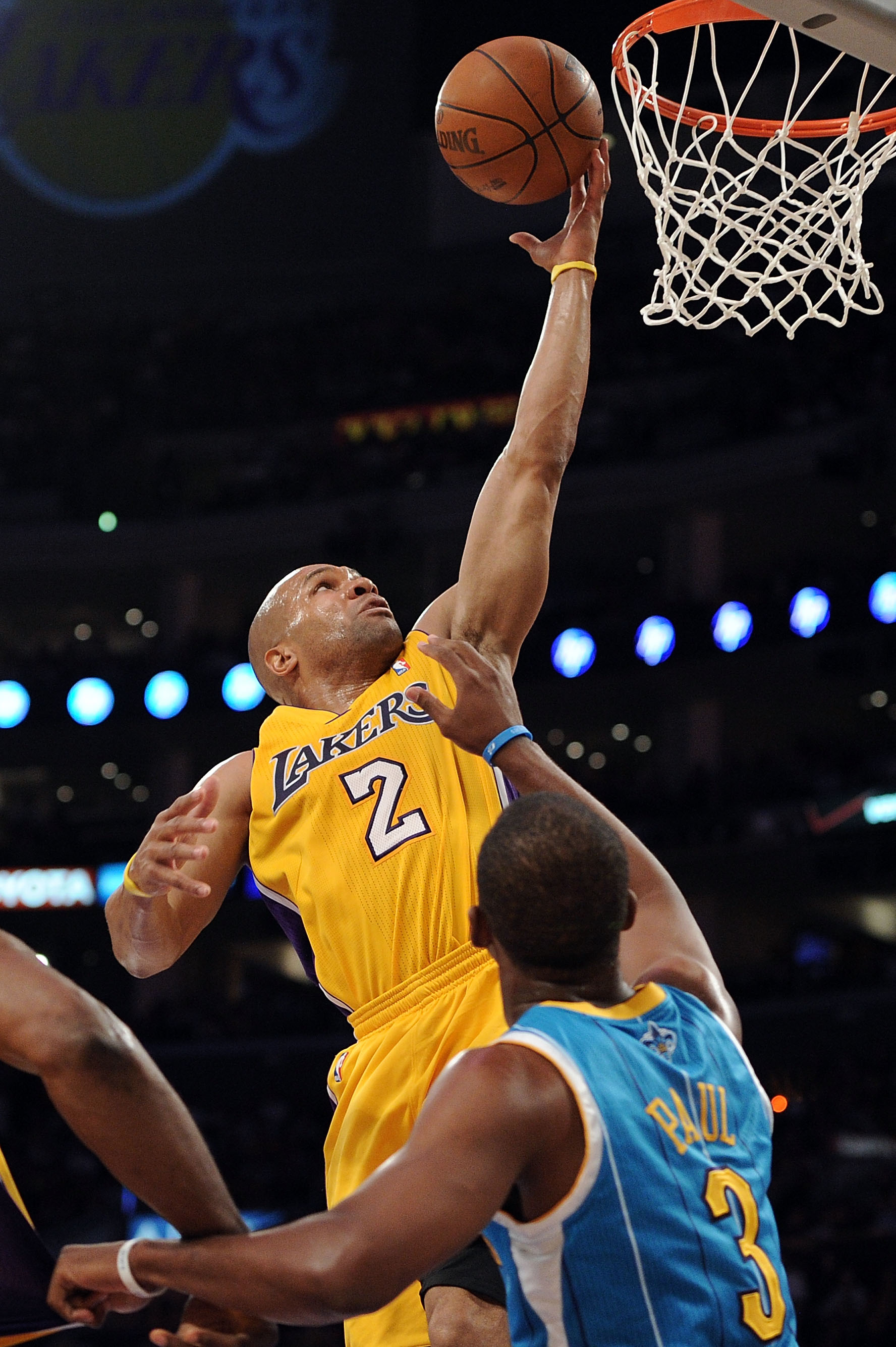 LOS ANGELES, CA - APRIL 20:  Derek Fisher #2 of the Los Angeles Lakers shoots over Chris Paul #3 of the New Orleans Hornets in the first quarter in Game Two of the Western Conference Quarterfinals in the 2011 NBA Playoffs on April 20, 2011 at Staples Cent