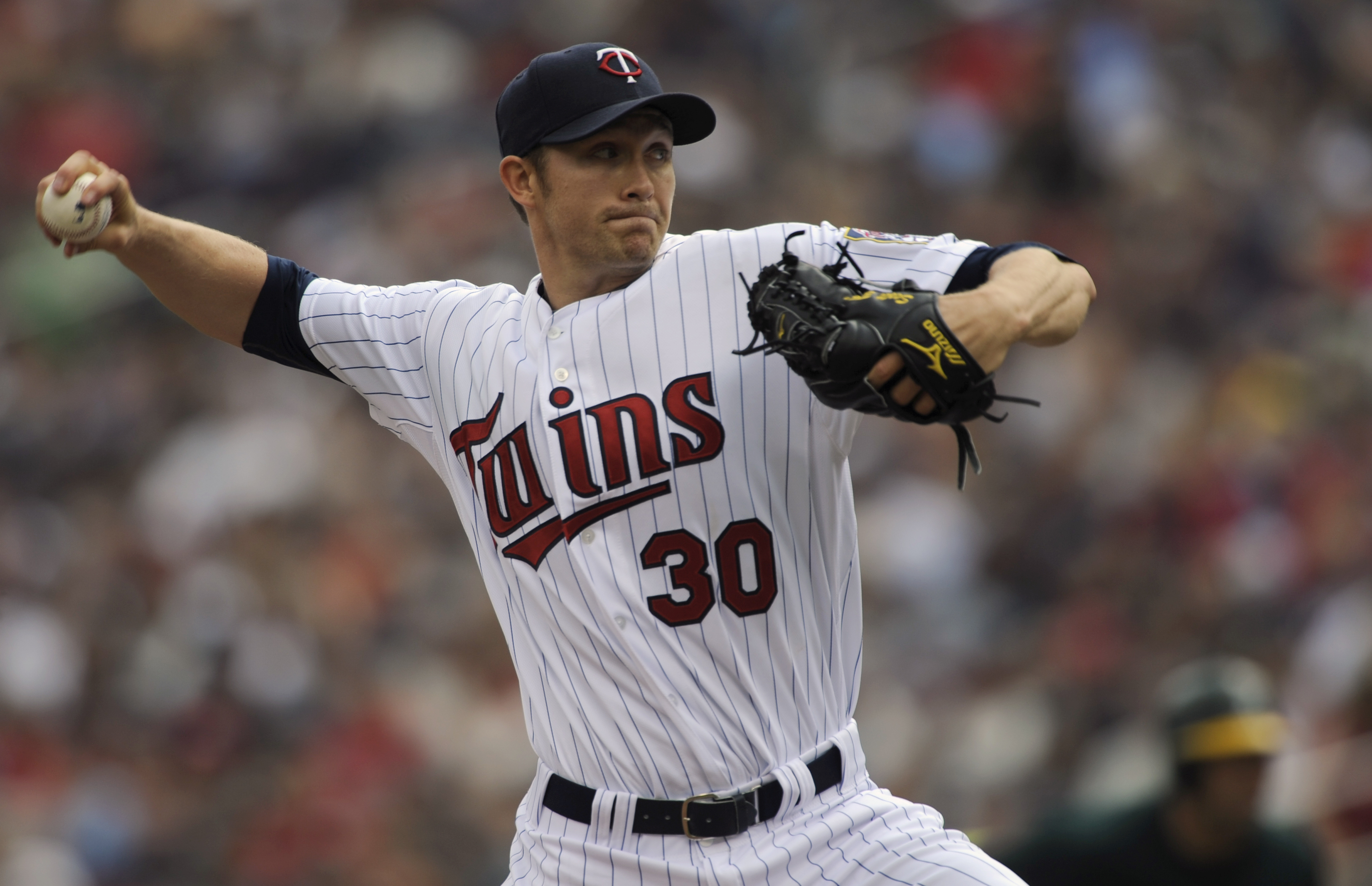 MINNEAPOLIS, MN - APRIL 10: Starting pitcher Scott Baker #30 of the Minnesota Twins throws against the Oakland Athletics during the first inning of a game on April 10, 2011 at Target Field in Minneapolis, Minnesota. (Photo by Hannah Foslien/Getty Images)