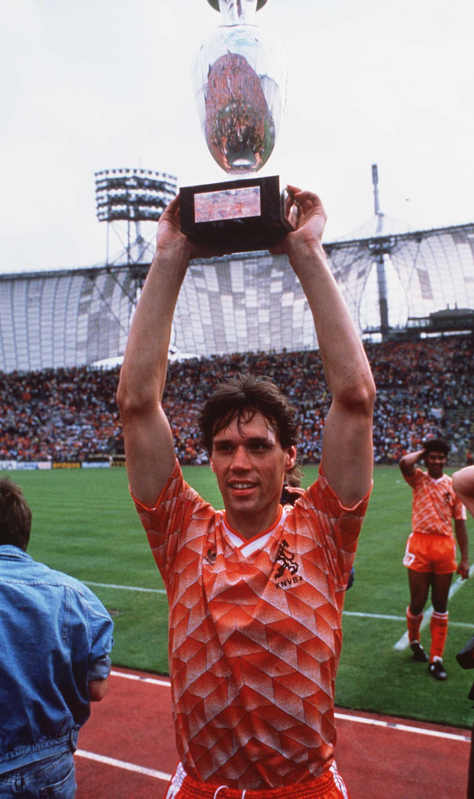 Holland's goalscoring hero Marco Van Basten lifts the European Championships trophy in 1988