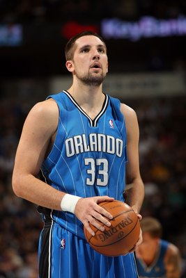 DENVER - JANUARY 13:  Ryan Anderson #33 of the Orlando Magic takes a takes a free throw against the Denver Nuggets during NBA action at Pepsi Center on January 13, 2010 in Denver, Colorado. The Nuggets defeated the Magic 115-97. NOTE TO USER: User express