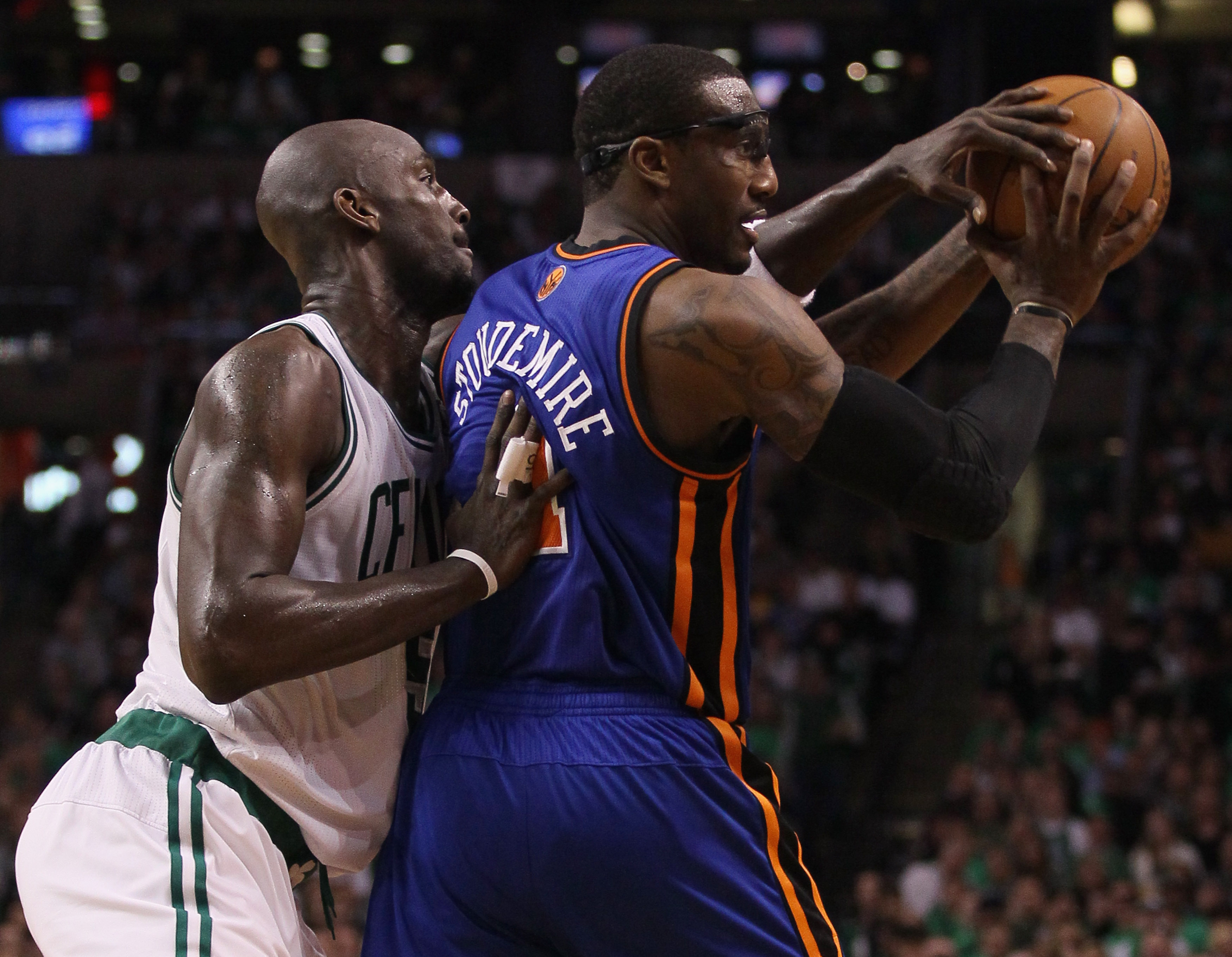 BOSTON, MA - APRIL 17:  Kevin Garnett #5 of the Boston Celtics tries to knock the ball away from Amare Stoudemire #1 of the New York Knicks   in Game One of the Eastern Conference Quarterfinals in the 2011 NBA Playoffs on April 17, 2011 at the TD Garden i