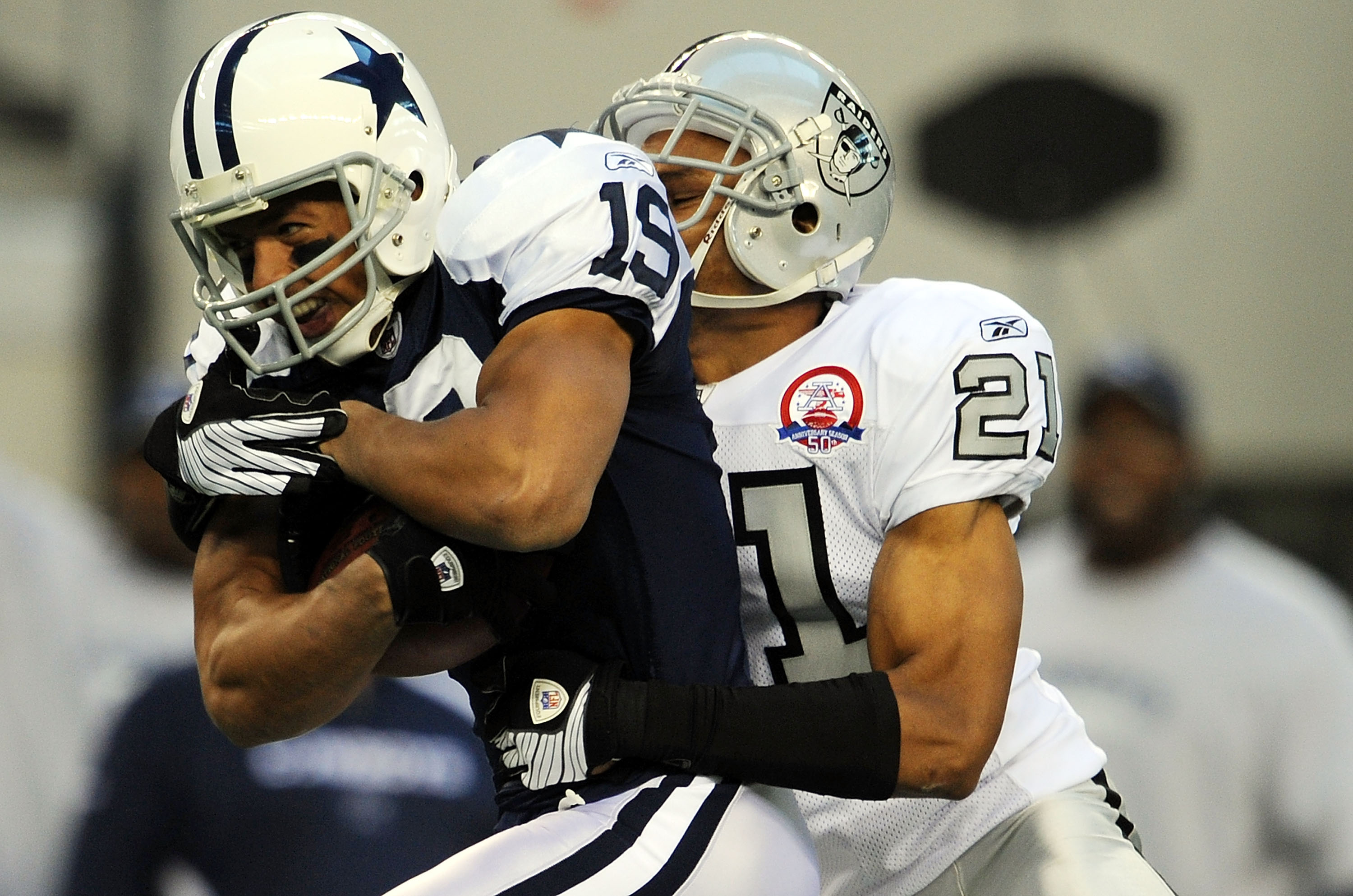 ARLINGTON, TX - NOVEMBER 26:  Wide receiver Miles Austin #19 of the Dallas Cowboys runs the ball against Nnamdi Asomugha #21 of the Oakland Raiders at Cowboys Stadium on November 26, 2009 in Arlington, Texas.  (Photo by Ronald Martinez/Getty Images)