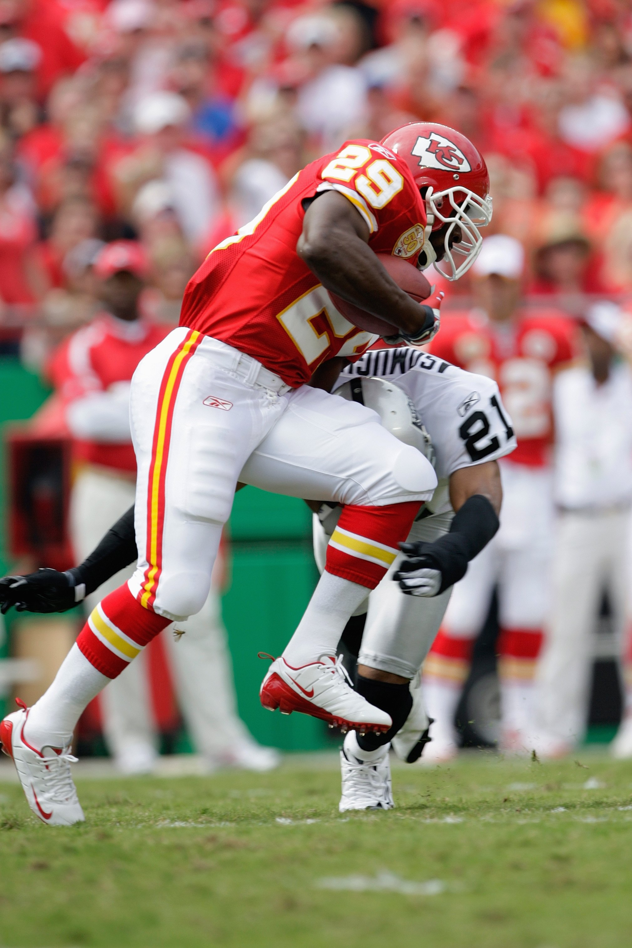 KANSAS CITY, MO - SEPTEMBER 20:  Dantrell Savage #29 of the Kansas City Chiefs carries the ball against Nnamdi Asomugha #21 of the Oakland Raiders during the game at Arrowhead Stadium on September 20, 2009 in Kansas City, Missouri. (Photo by Jamie Squire/