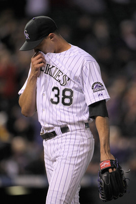 DENVER, CO - APRIL 19:  Starting pitcher Ubaldo Jimenez #38 of the Colorado Rockies heads to the dugout as he faces the San Francisco Giants at Coors Field on April 19, 2011 in Denver, Colorado. Jimenez collected the loss as the Giants defeated the Rockie