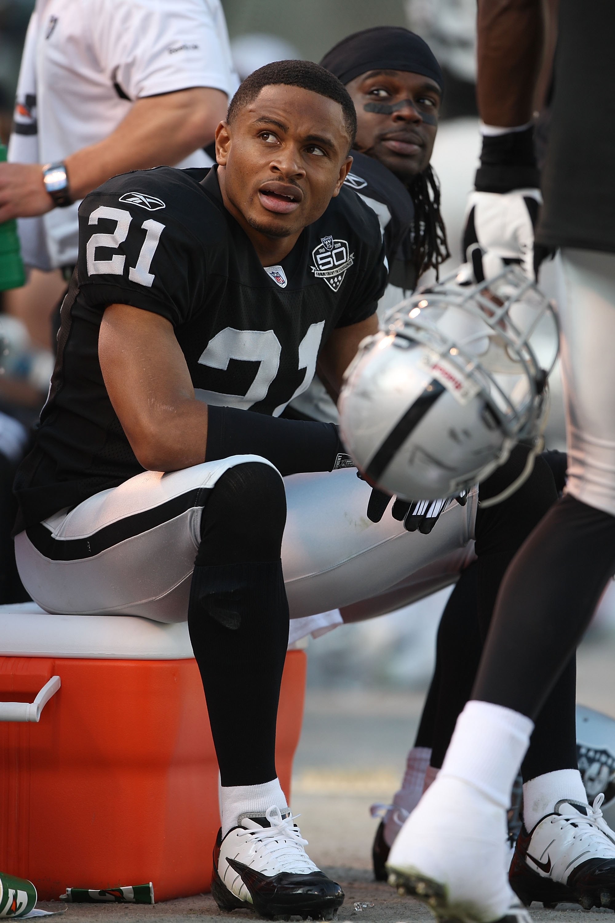 OAKLAND, CA - JANUARY 03:  Nnamdi Asomugha #21 of the Oakland Raiders sits on the bench against the Baltimore Ravens during an NFL game at Oakland-Alameda County Coliseum on January 3, 2010 in Oakland, California.  (Photo by Jed Jacobsohn/Getty Images)