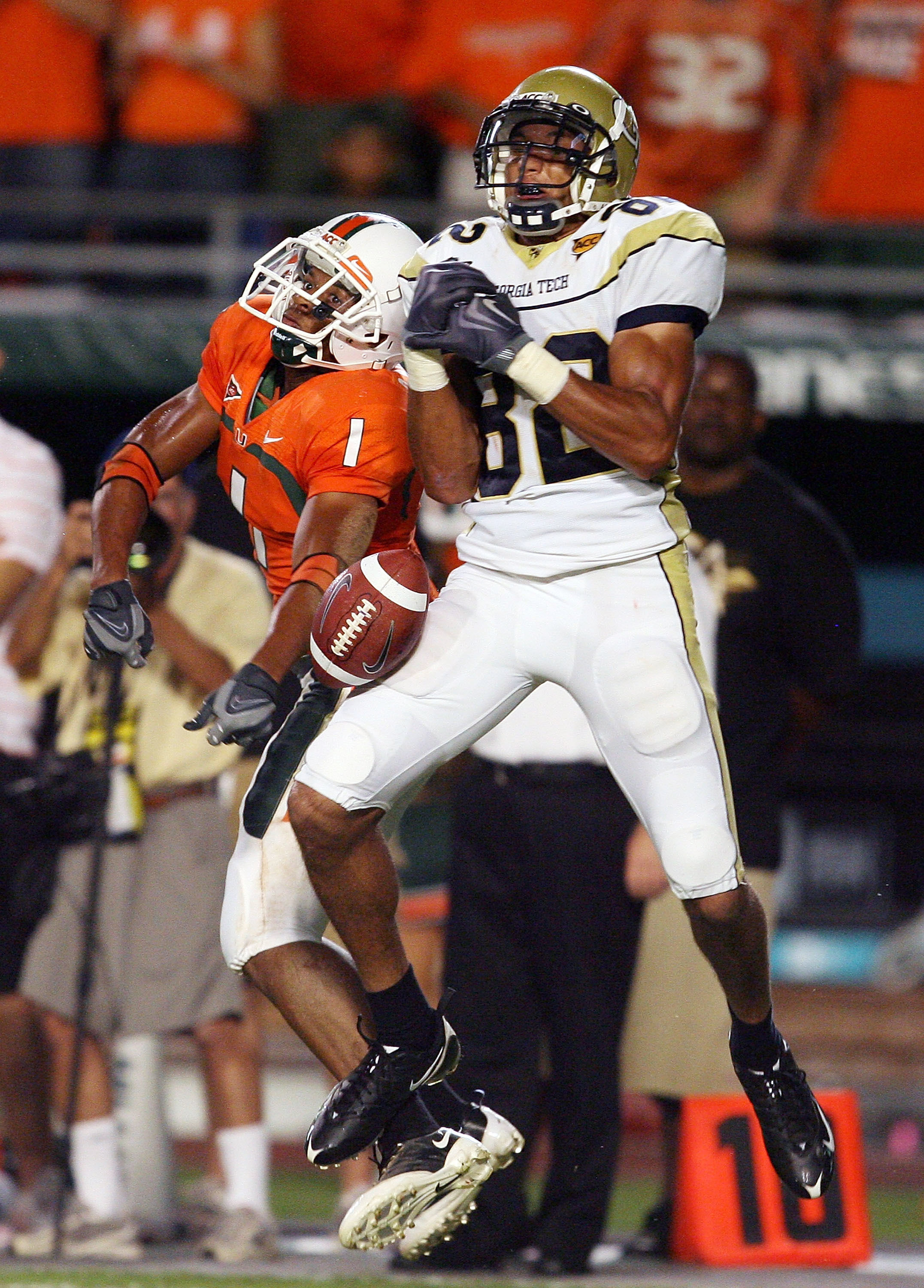 FORT LAUDERDALE, FL - SEPTEMBER 17:  Defensive back Brandon Harris #1 of the Miami Hurricanes breaks up a pass intended for wide receiver Kevin Cone #82 of the Georgia Tech Yellow Jackets at Land Shark Stadium on September 17, 2009 in Fort Lauderdale, Flo